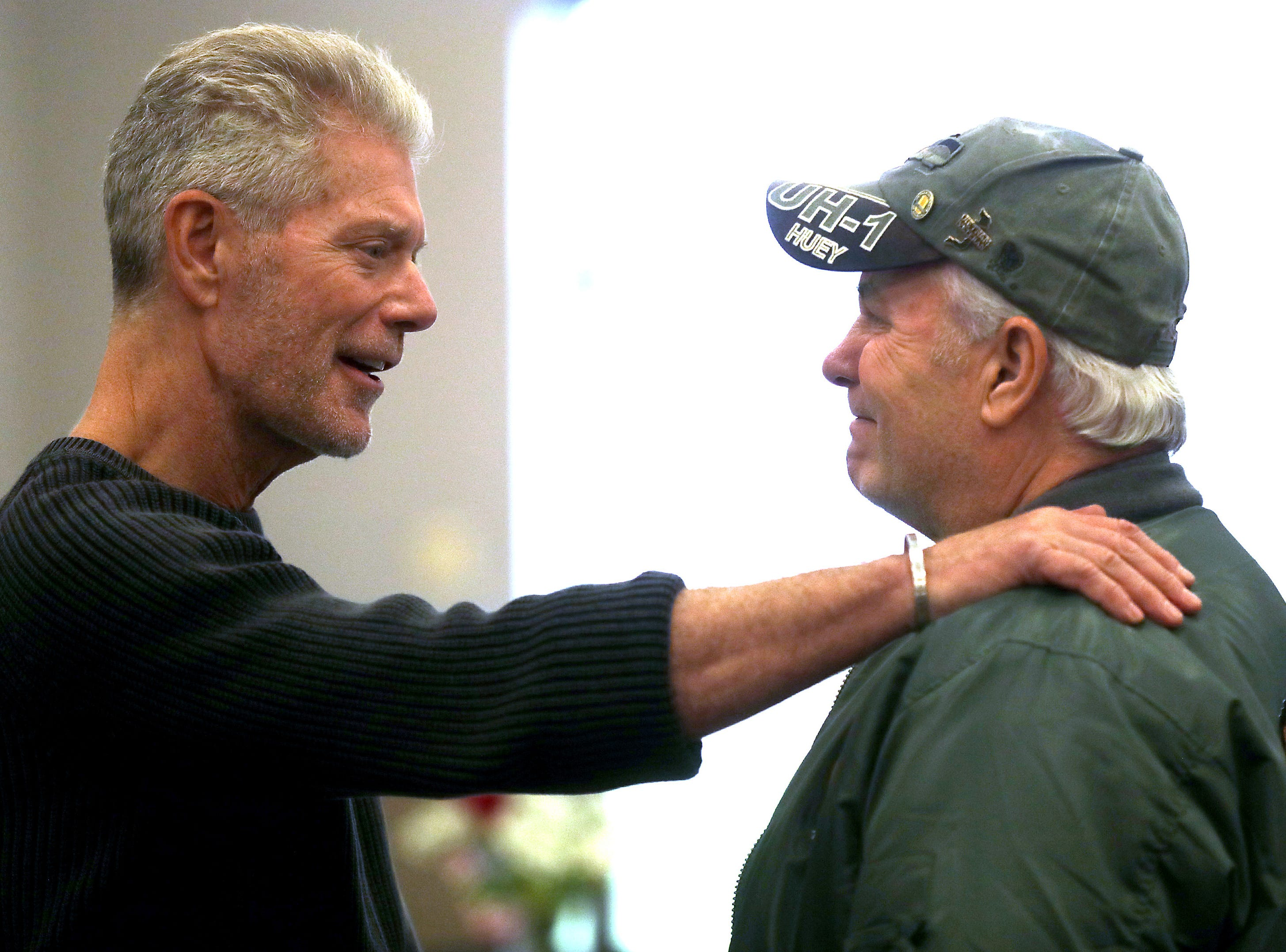 Actor Stephen Lang, left, speaks with U.S. Army veteran Bruce Leavitt, who served in Vietnam, during the 