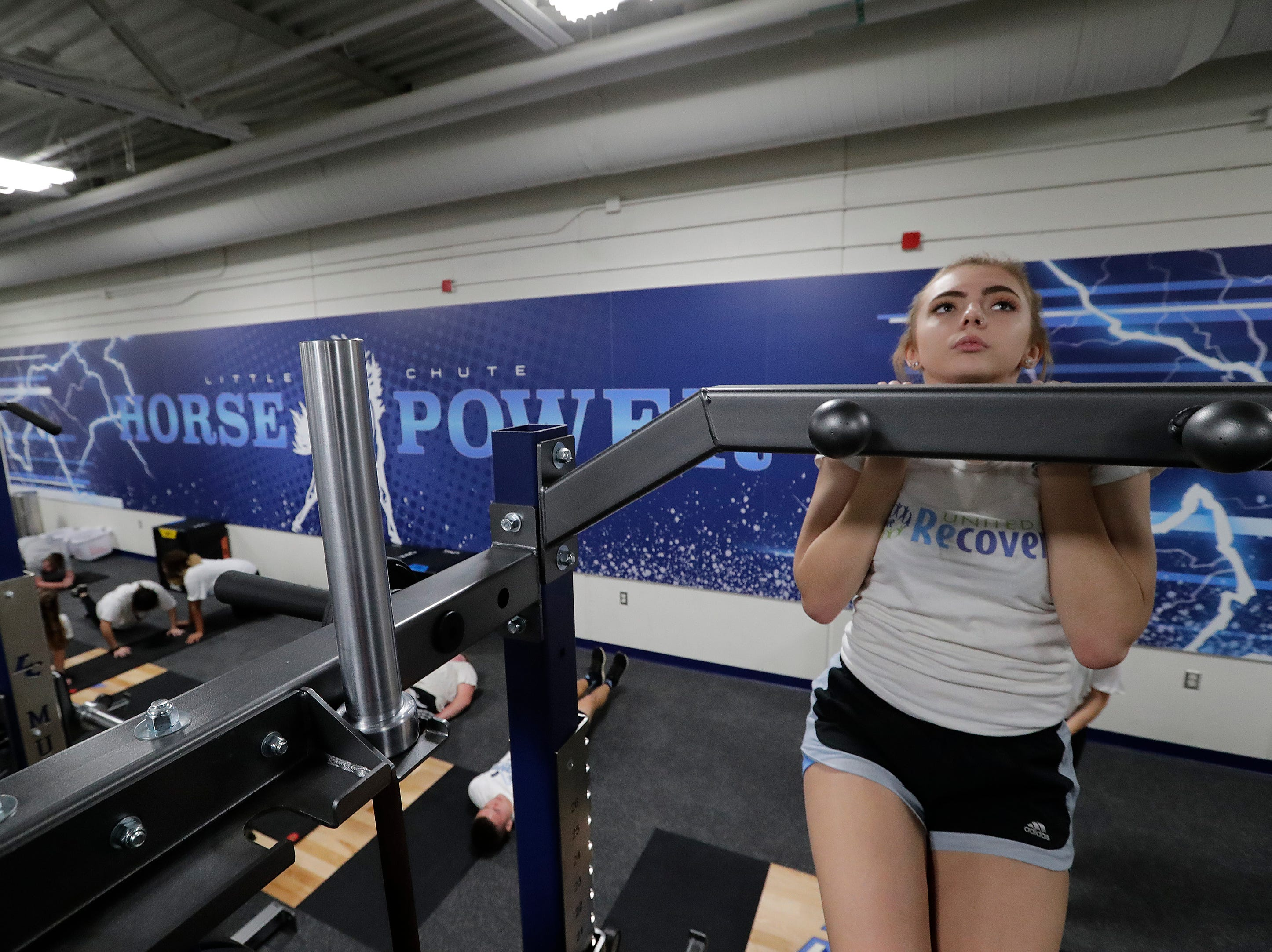Madison Withrow does chin ups as she participates in the Intro to Strength and Conditioning class in the new fitness center at Little Chute High School Tuesday, November 6, 2018, in Little Chute, Wis. 