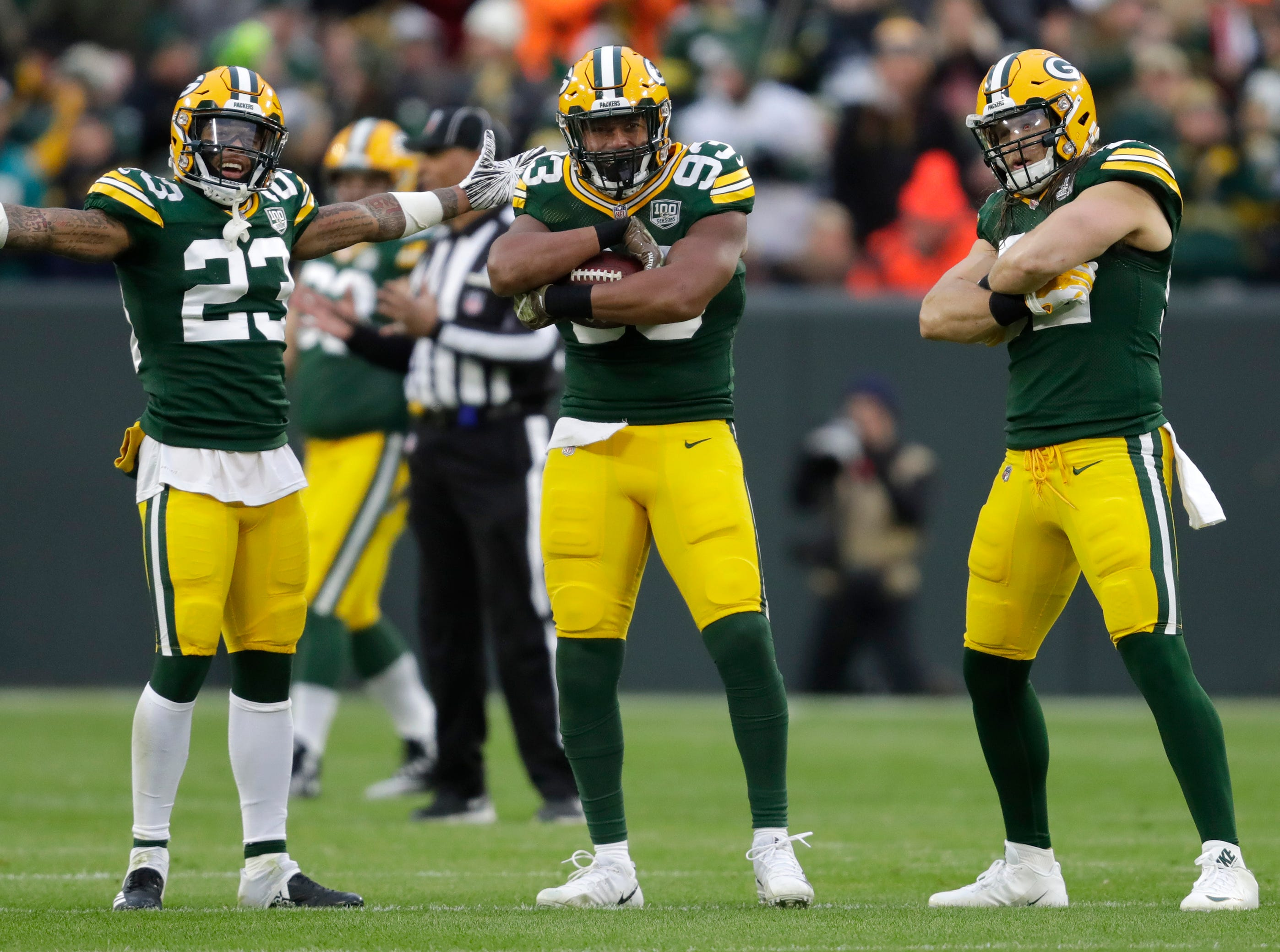 Green Bay Packers linebacker Reggie Gilbert (93) celebrates his fumble recovery with Jaire Alexander (23) and Clay Matthews (52) in the first quarter Sunday, November 11, 2018, Lambeau Field in Green Bay, Wis. 