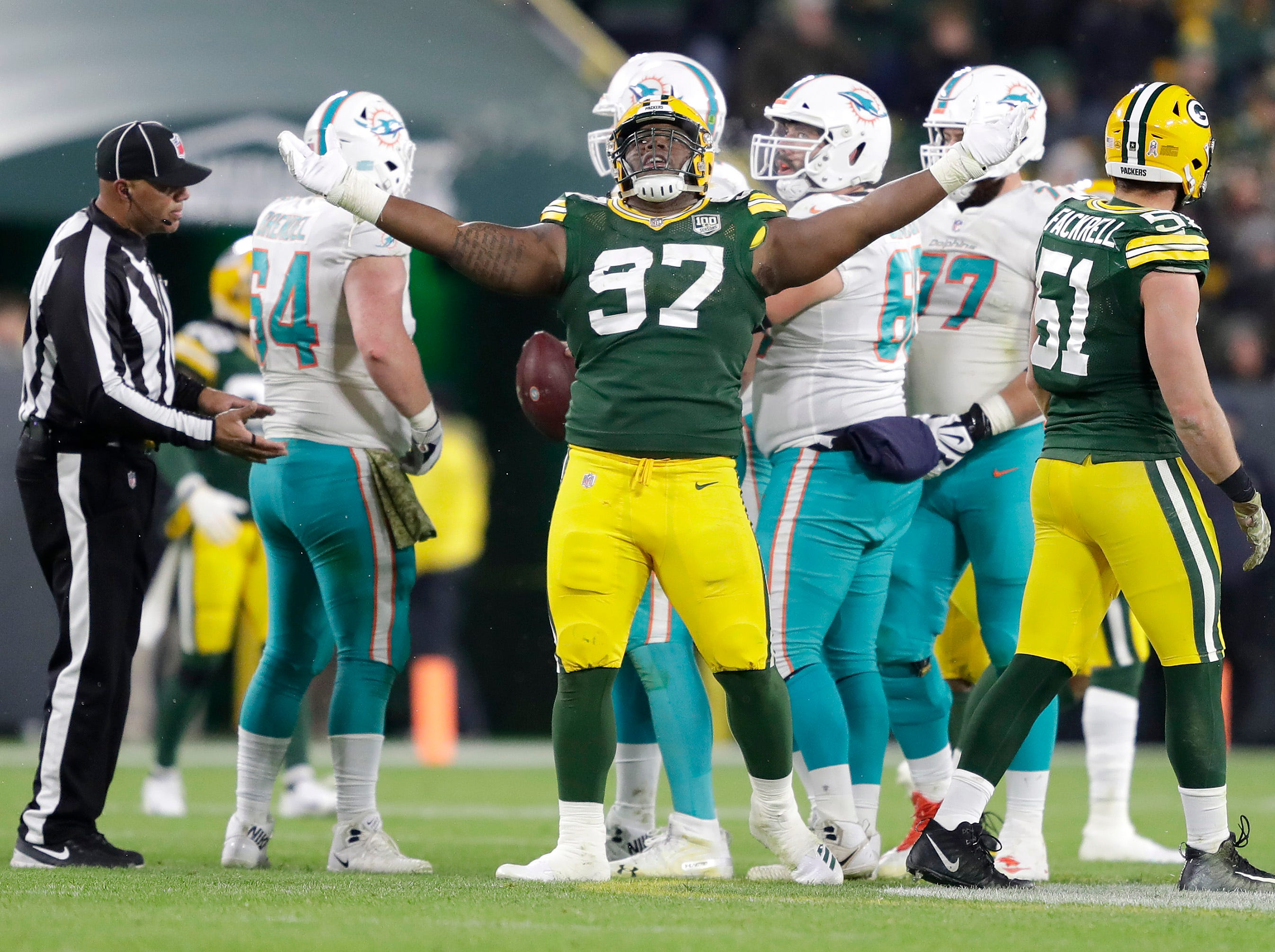 Green Bay Packers nose tackle Kenny Clark celebrates a sack against the Miami Dolphins during their football game on Sunday, November 11, 2018, at Lambeau Field in Green Bay, Wis.