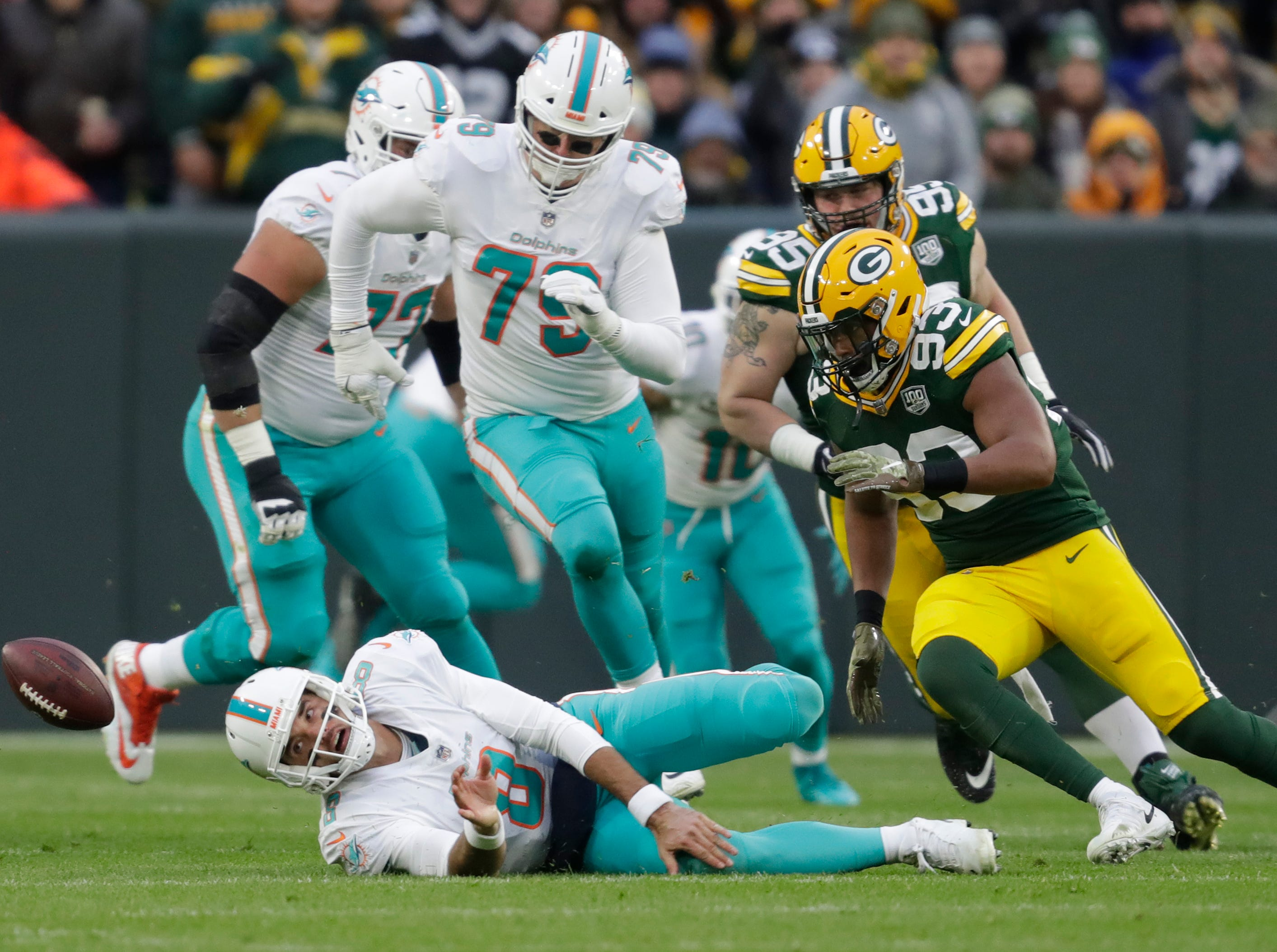 Green Bay Packers linebacker Reggie Gilbert (93) moves in to recover a fumble by Miami Dolphins quarterback Brock Osweiler (8) in the first quarter Sunday, November 11, 2018, Lambeau Field in Green Bay, Wis. 