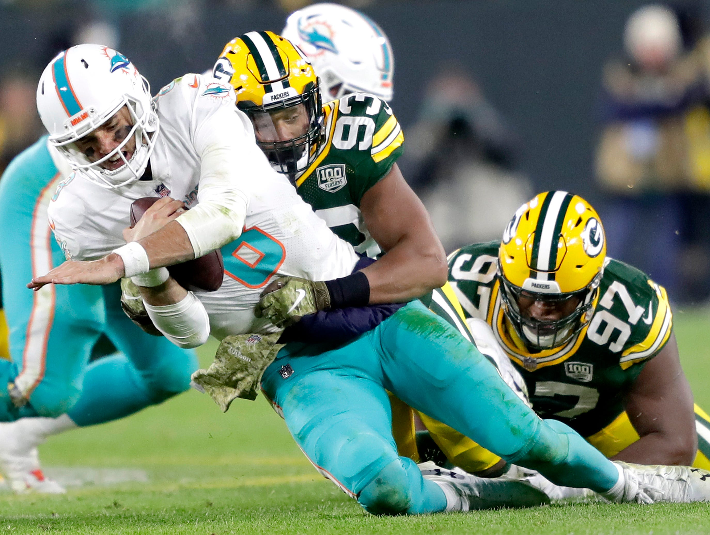 Green Bay Packers linebacker Reggie Gilbert sacks Miami Dolphins quarterback Brock Osweiler in the fourth quarter of their football game on Sunday, November 11, 2018, at Lambeau Field in Green Bay, Wis. Green Bay defeated the Dolphins 31 to 12.