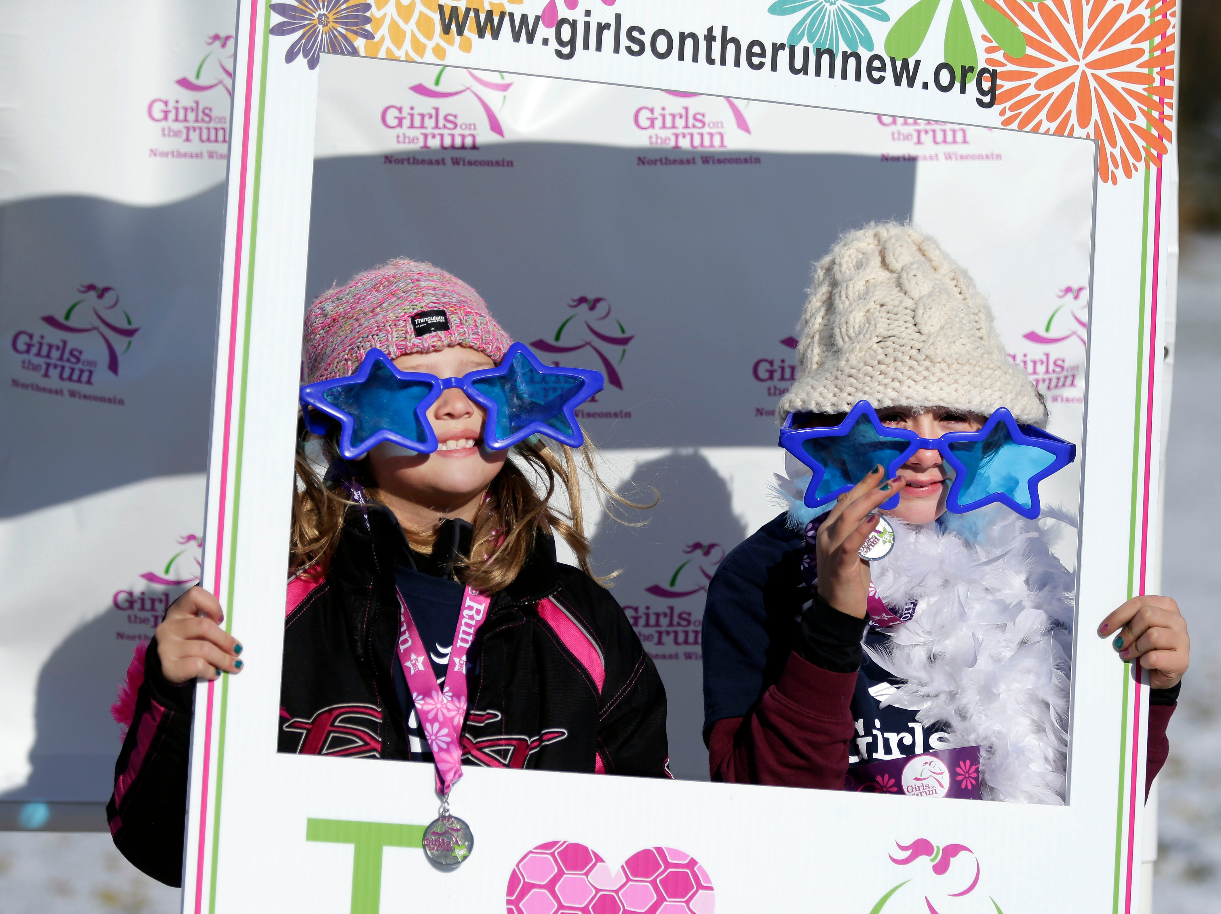 Mckenna Erickson, left, Isabella Theel, pose for a photo following the Girls on the Run Celebration 5K Saturday, November 10, 2018, at FVTC in Appleton, Wis. The event completes a 10-week program teaching life skills to inspire and empower girls.