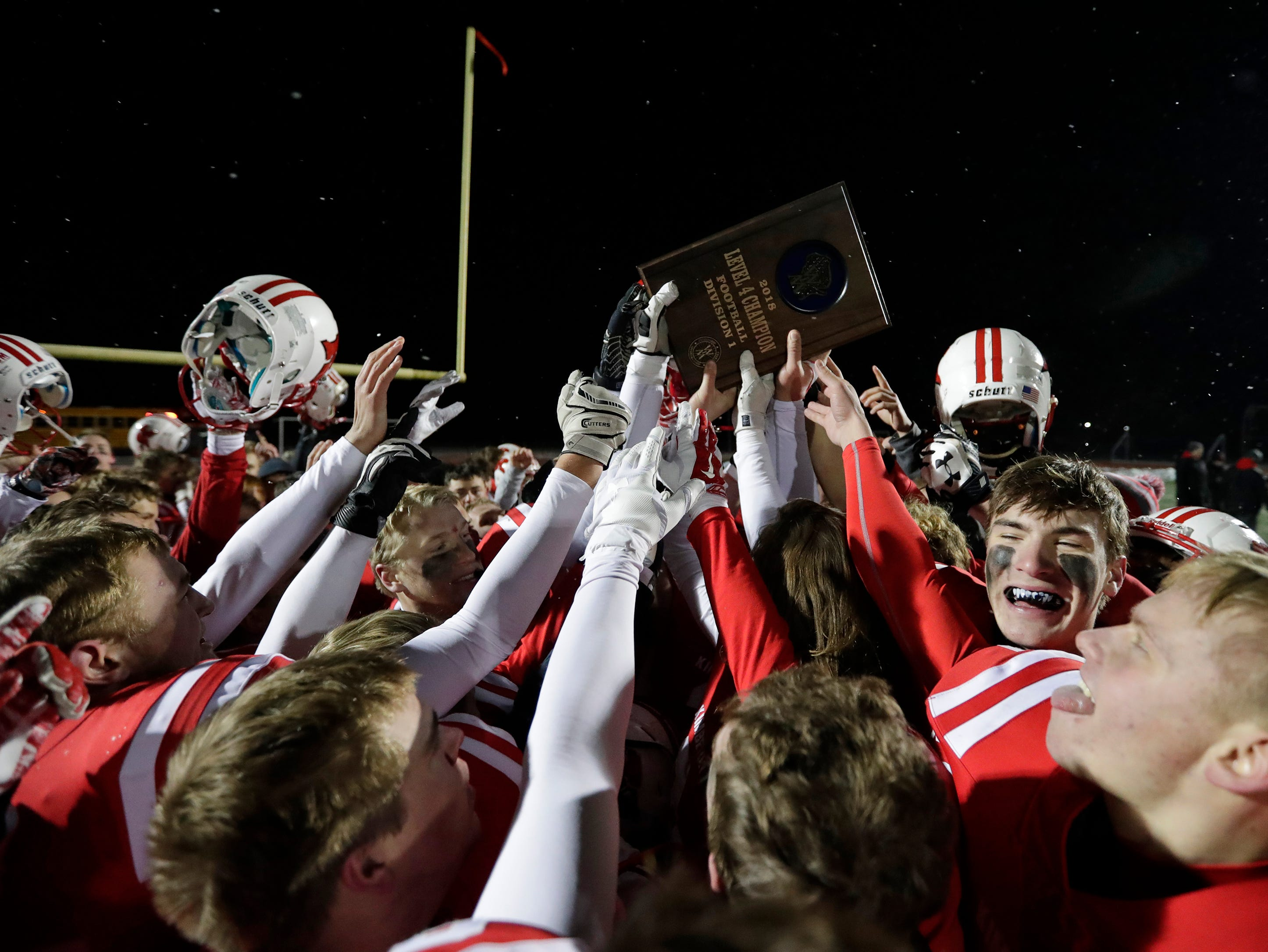 Kimberly High School's players celebrate their 22-21 overtime victory against Fond du Lac High School during their WIAA Division 1 state semifinal football game Friday, November 9, 2018, at Titan Stadium in Oshkosh, Wis. 