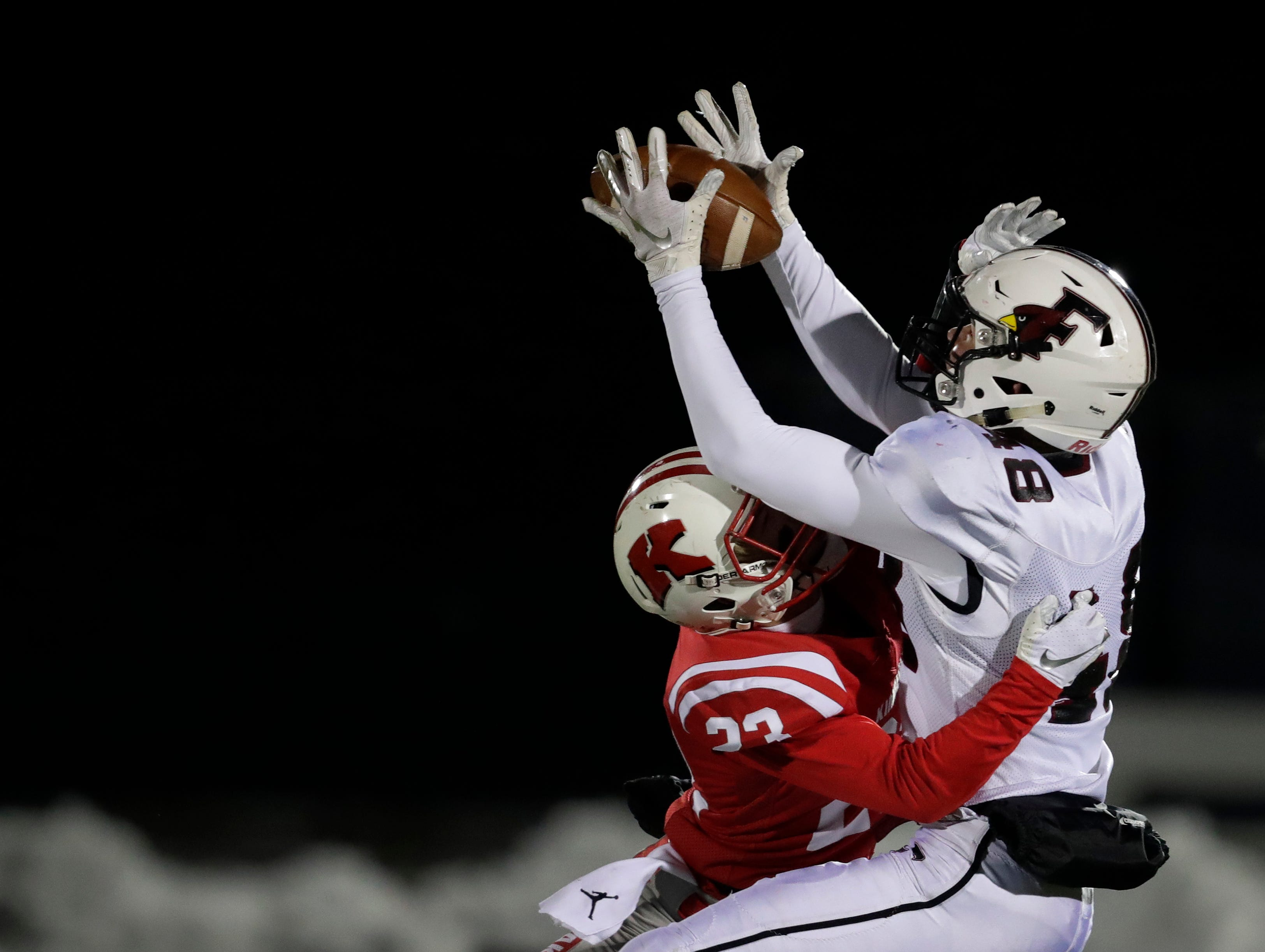 Kimberly High School's Zach Olson (23) breaks up a pass intended for against Fond du Lac High School's Adam Hopper (48) during their WIAA Division 1 state semifinal football game Friday, November 9, 2018, at Titan Stadium in Oshkosh, Wis. 