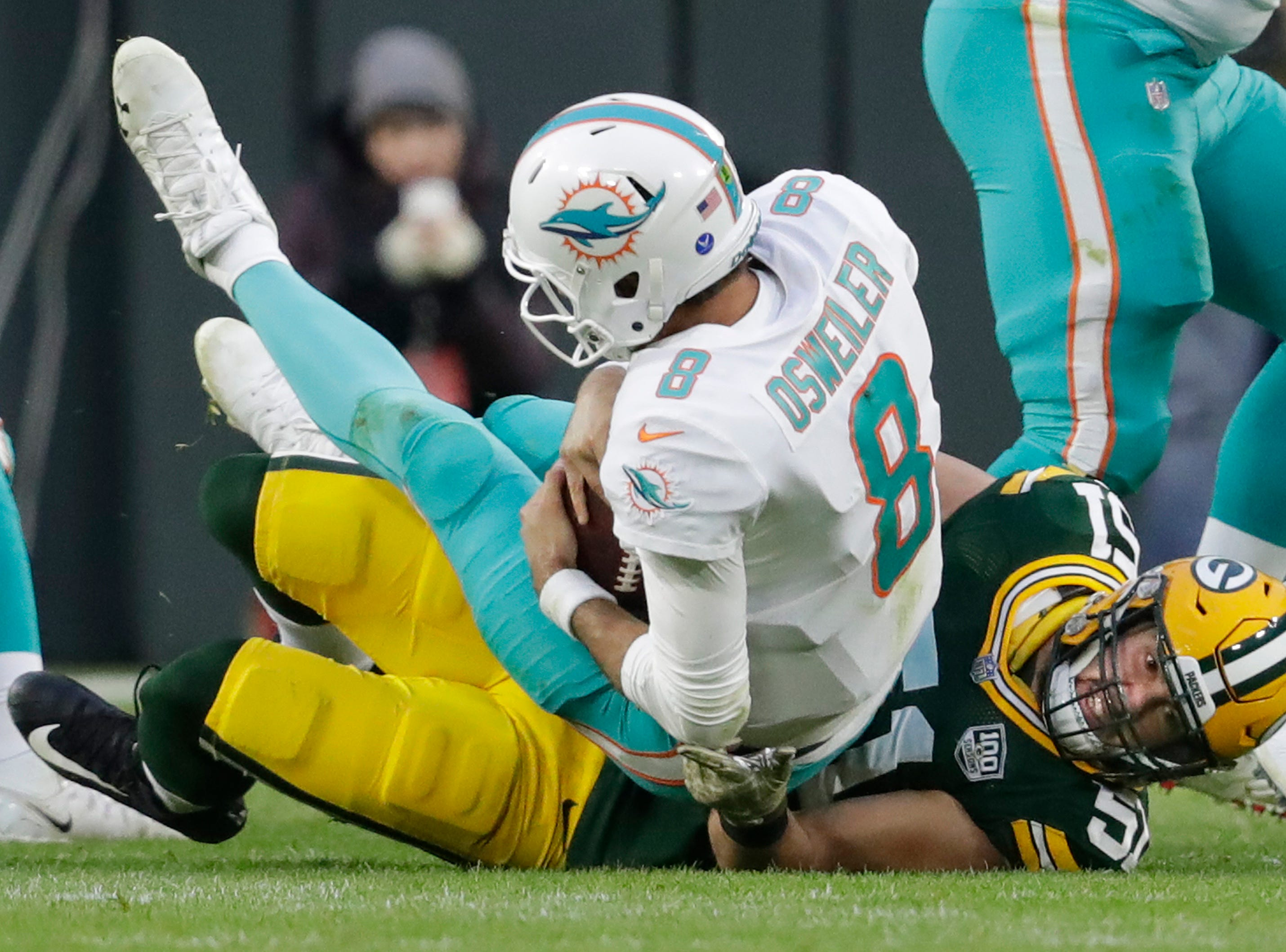Green Bay Packers linebacker Kyler Fackrell (51) sacks Miami Dolphins quarterback Brock Osweiler (8) in the first quarter Sunday, November 11, 2018, Lambeau Field in Green Bay, Wis. 