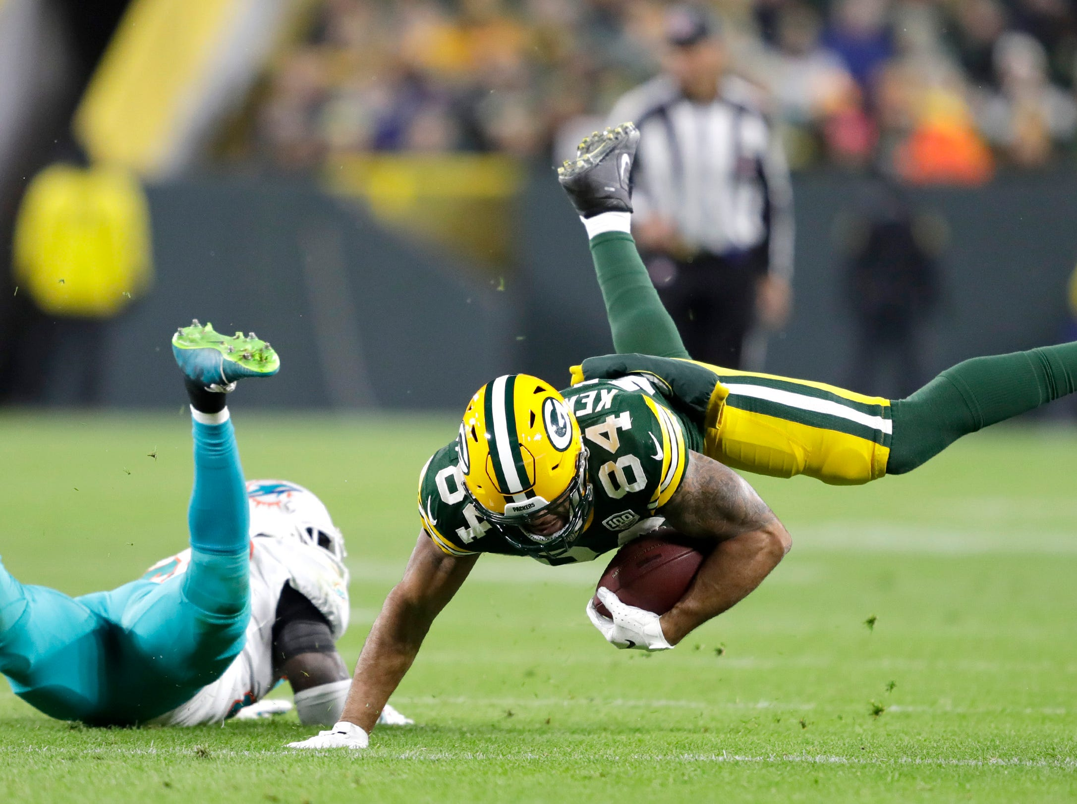 Green Bay Packers tight end Lance Kendricks makes a fourth quarter reception against the Miami Dolphins during their football game on Sunday, November 11, 2018, at Lambeau Field in Green Bay, Wis. 