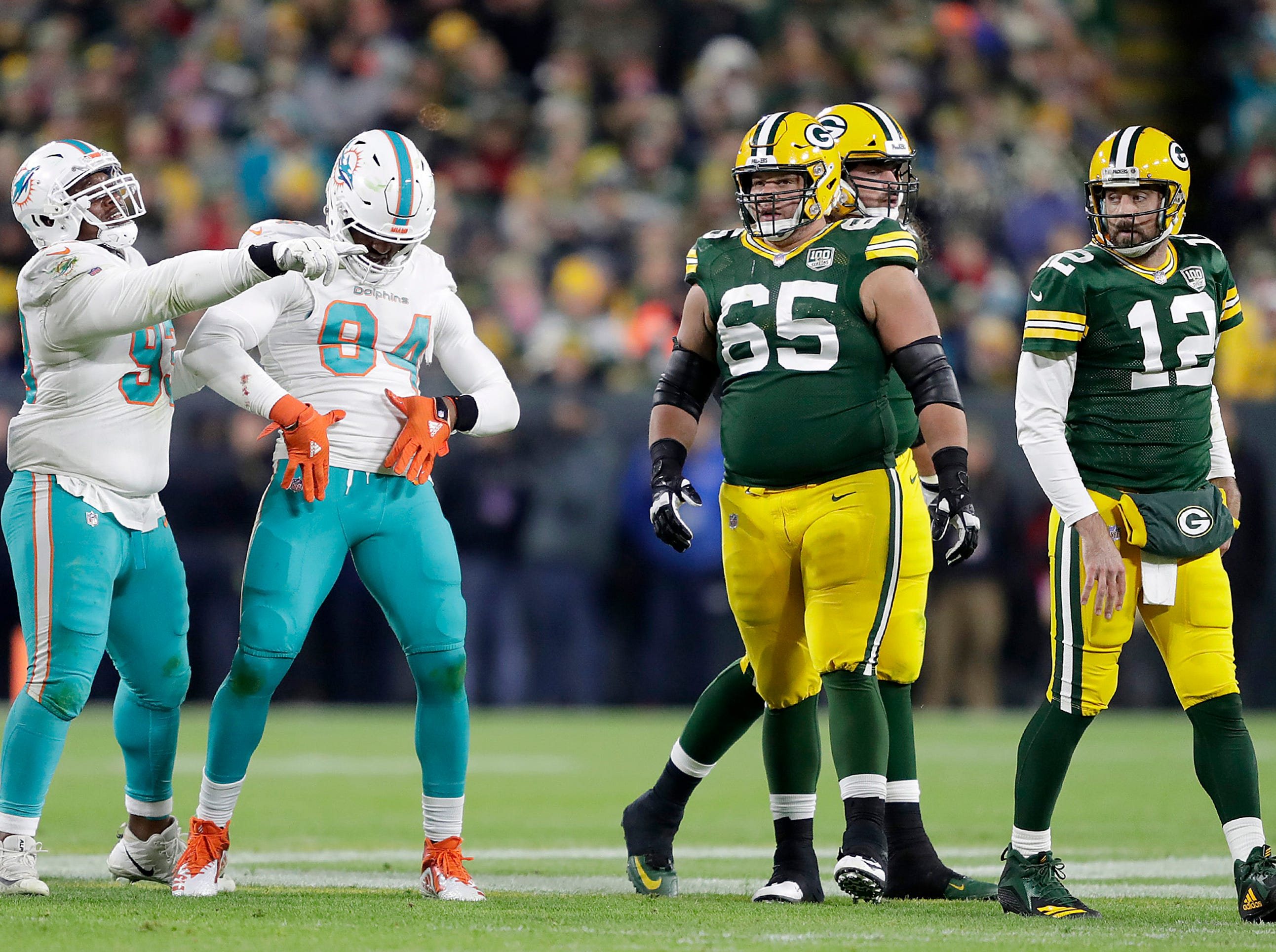 Miami Dolphins defensive end Robert Quinn celebrates after sacking Green Bay Packers quarterback Aaron Rodgersduring their football game on Sunday, November 11, 2018, at Lambeau Field in Green Bay, Wis.