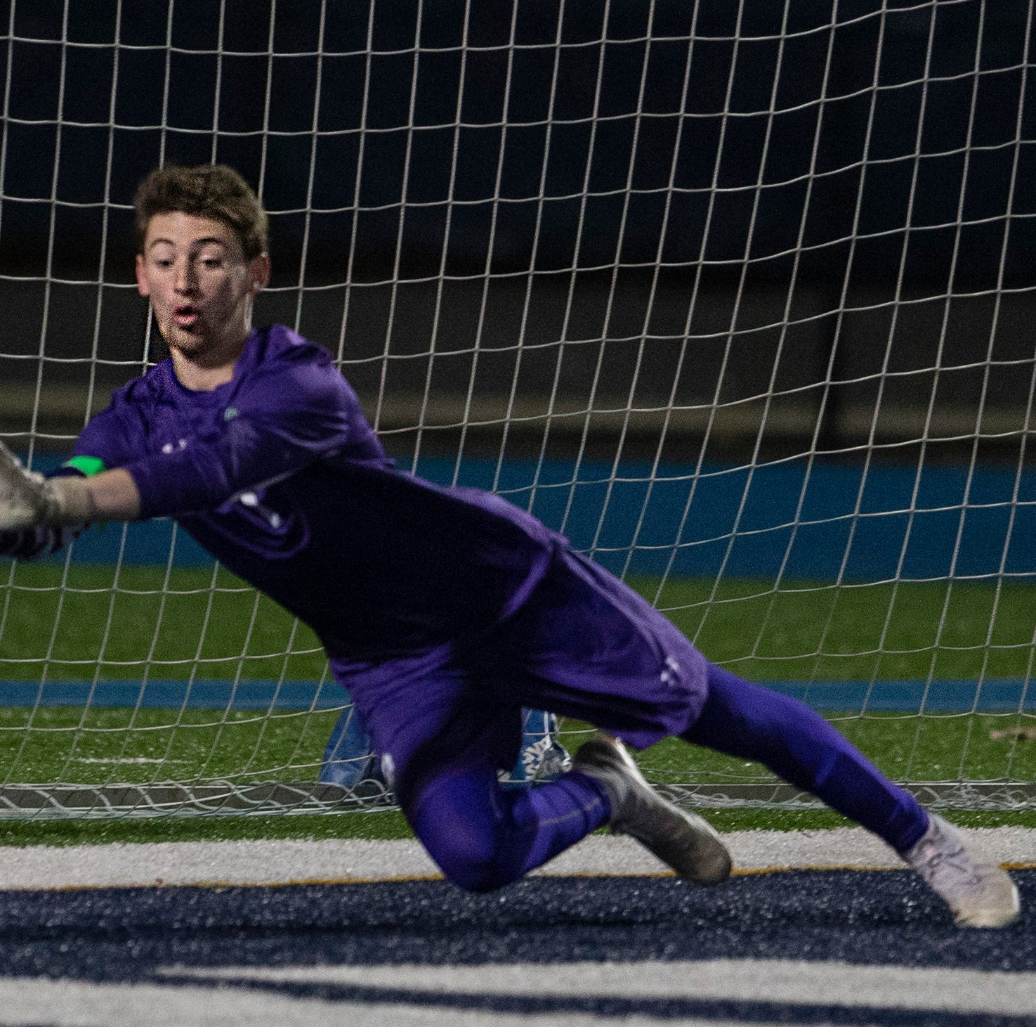 Delbarton's goalie Kyle Swift tries but can push away game winning goal during closing minute of second overtime. Christian Brothers Academy defeat Delbarton 2-1 in overtime during NJISSA Boys Non-public A State Soccer Final
