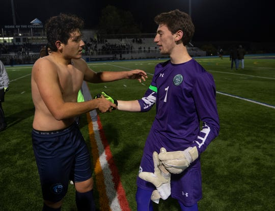 CBA's Luke Pascarella shakes hands with Delbarton goalie Kyle Swift after scoring the game winning goal. Christian Brothers Academy defeat Delbarton 2-1 in overtime during NJISSA Boys Non-public A State Soccer Final