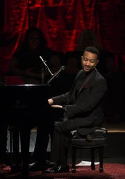 John Legend, pictured in 2014, will be in Atlantic City on Black Friday.