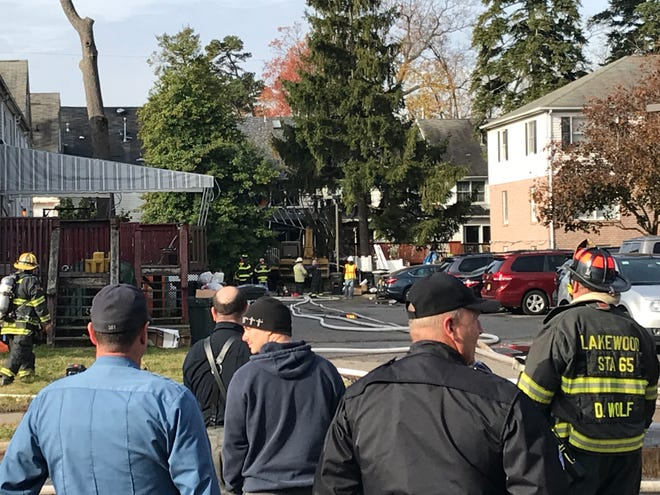 Firefighters were overhauling fire-damaged buildings in Lakewood Monday morning.