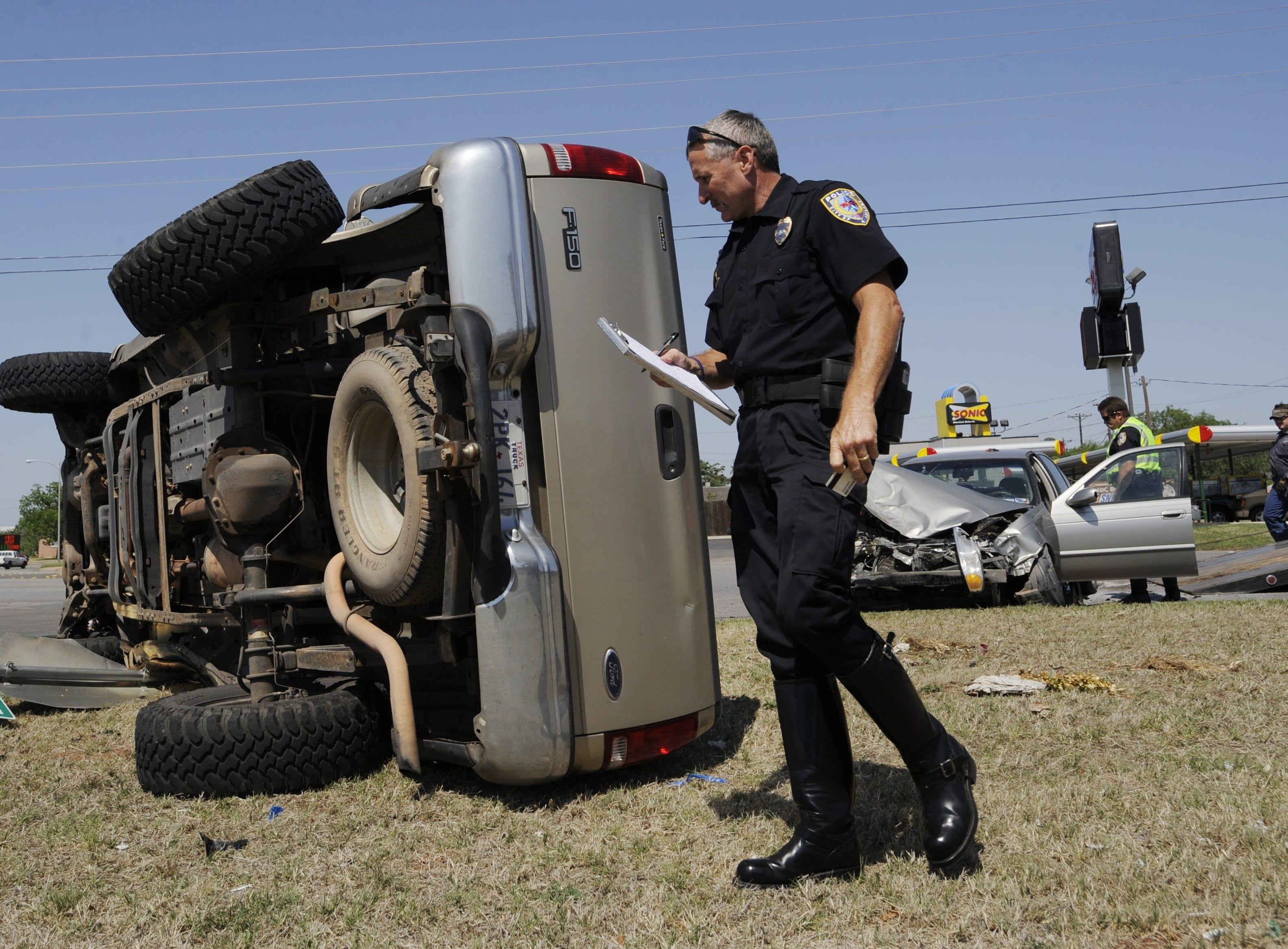 Rodney Holder surveys the scene of an accident.