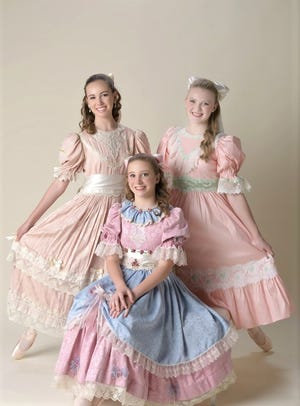 """The three Claras for the 2018 productions of """"The Nutcracker"""" by Abilene Ballet Theatre are, from left, Lily Etter, Hope Longley (kneeling) and Berkley Paul."""