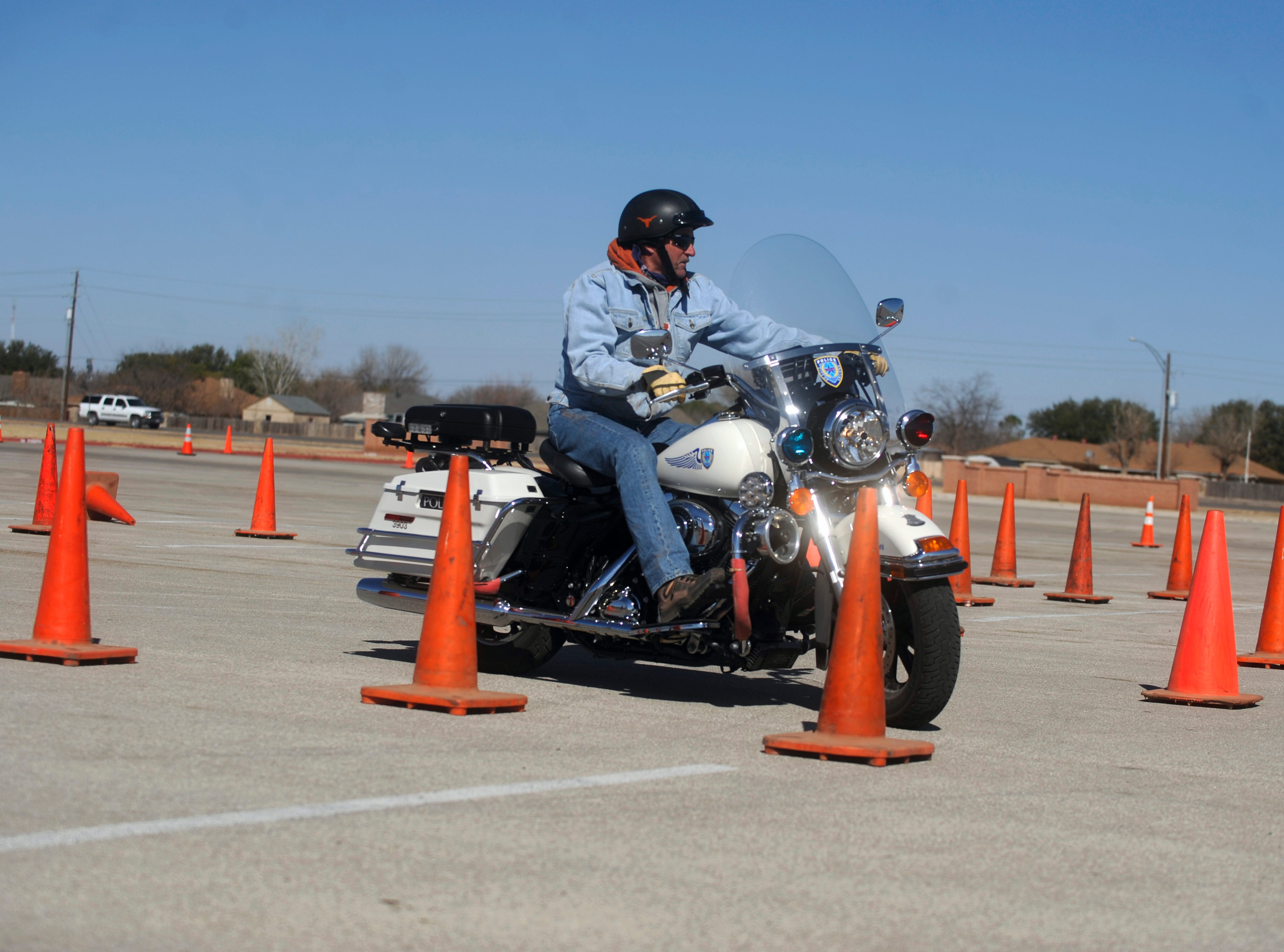 Rodney Holder goes through the police motorcycle re-training course at the Shotwell Stadium parking lot Feb. 11, 2009.
