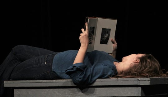 "Jen Tracy (Madison Massey) reads during this rehearsal scene of ""John & Jen,"" Abilene Christian University's production that features one other actor, Carl Kimbrough. Both are seniors."