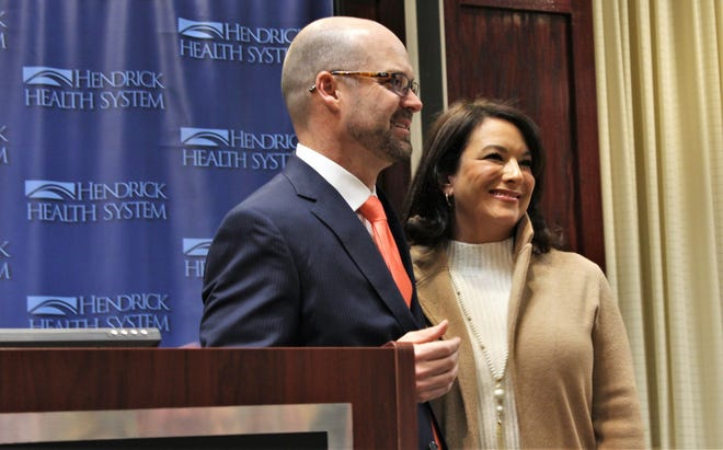 Brad Holland and his wife, Julianne, react to applause after the next Hendrick Health System president and CEO called her to the podium during his introduction Monday afternoon at Hendrick Medical Center. Holland will succeed Tim Lancaster, who is retiring Dec. 31.