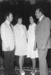 Dr. Jimmy McNeil and his wife Dot talk with Dr. and Mrs. Howard P. Winton, of Melbourne, Florida, after Dr. Winton's installation as president of the American Optometric Association in Hot Springs, Arkansas. Dr. McNeil was president of the Texas Optometric Association.