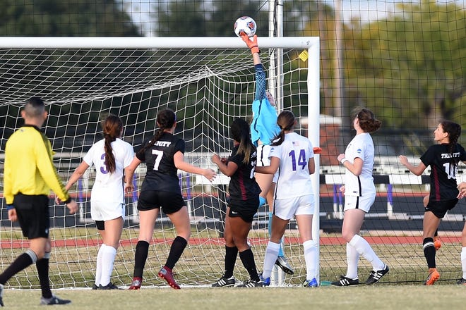 Hardin-Simmons keeper Caitlin Christiansen (34) pushes a Trinity shot over the cross bar during the second round of the NCAA Division III tournament last week. The Cowgirls travel to Vermont for the third and fourth rounds and take an eight-game shutout streak with them.