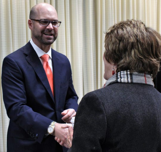 Brad Holland meets those attending Monday's announcement that the former San Angelo hospital administrator would succeed retiring Tim Lancaster at president and CEO of Hendrick Health System.