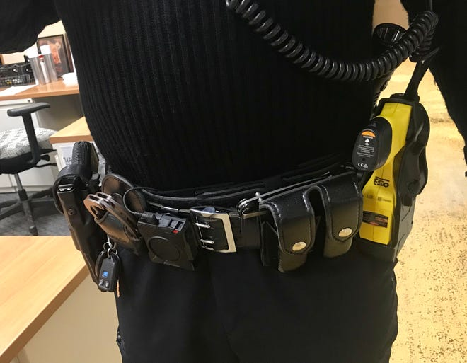 Asheville police officers carry about 30 pounds of gear, including a 9mm pistol, a Taser, extra ammo and handcuffs. Officers are trained to carry their pistol and Taser on opposite sides of the body, with the Taser on the less dominant side.
