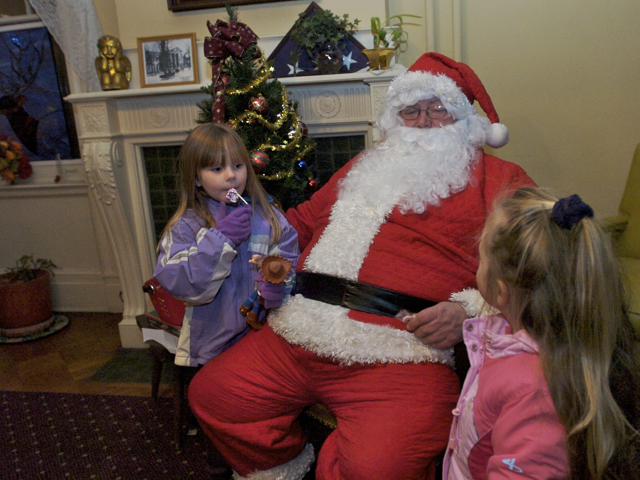 Santa Claus visits with best friends Trinity Brewster, left, and Shannon McMahon, both four-year-olds from the Town of Maine, for the annual Lights on the River event in Owego in 2010.