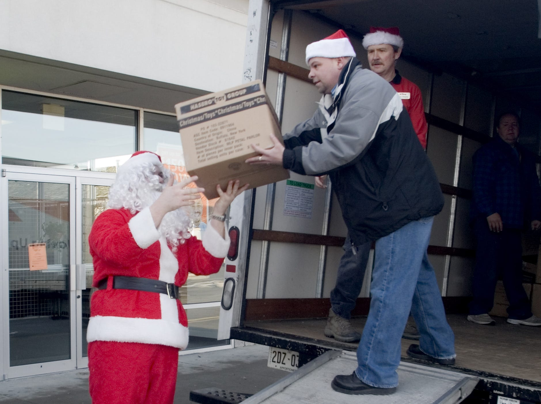 In 2006, Tops boosts Salvation Army Tops Friendly Markets employees Jeremy Stone, left, dressed as Santa Claus, Jim Butts, center, and Tom Petzke load a truck Thursday morning with $5,000 worth of toys donated to the Salvation Army. The toys, along with a $1,100 donation, were paid for by donations from store customers in Elmira and Big Flats.