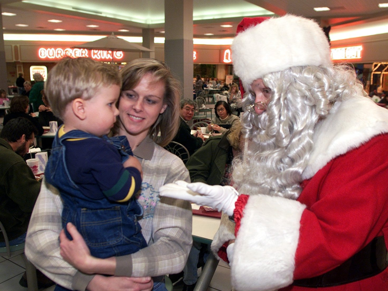 In 200o, Santa Claus meets 18-month-old Cameron Elliot and his mother, Robin Elliot of Savona, at the Arnot Mall on Friday night. Santa was making his arrival to the mall -- and the start of the shopping season.