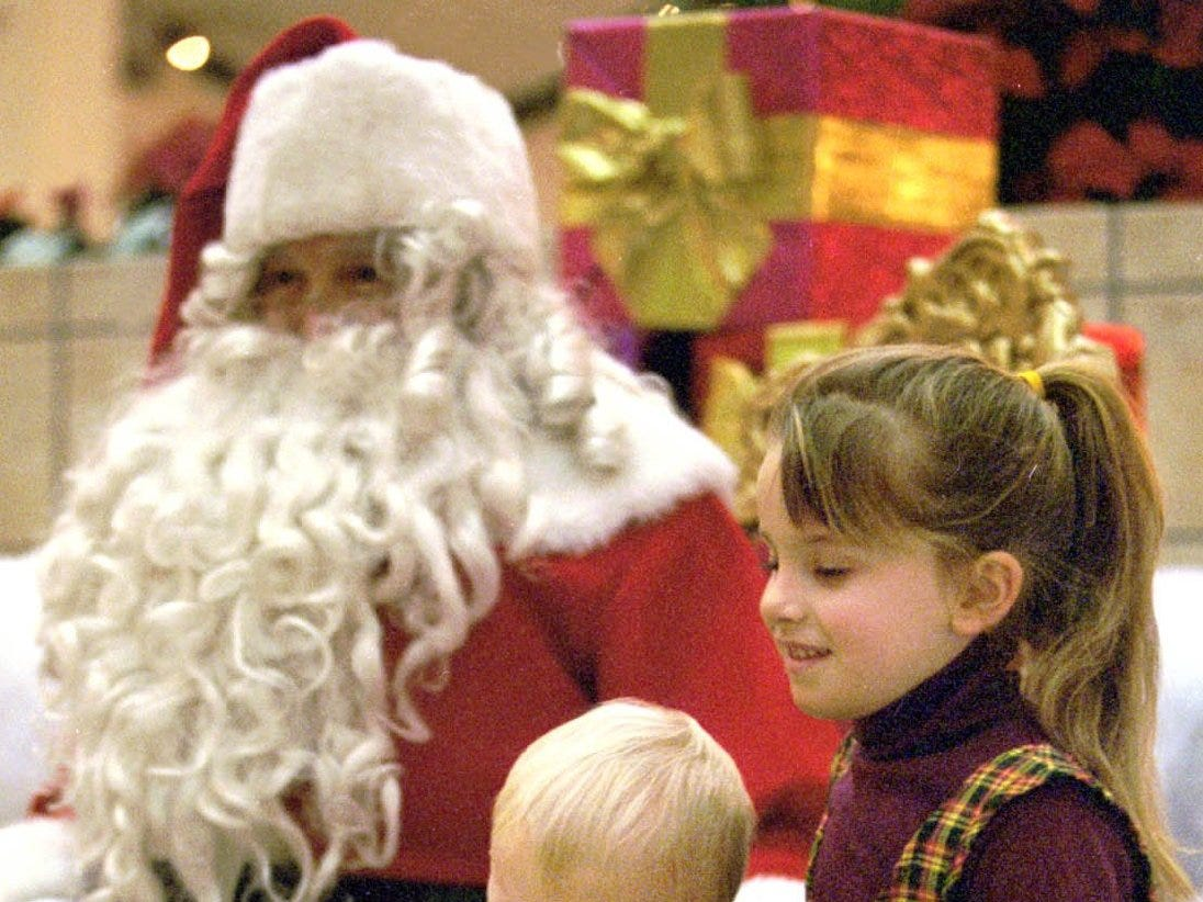 Matthew  Rozengota, 15 months, and Andrea Rozengota, 6 , of Elmira,  get their photograph taken with Santa Claus at Arnot Mall in 1998.