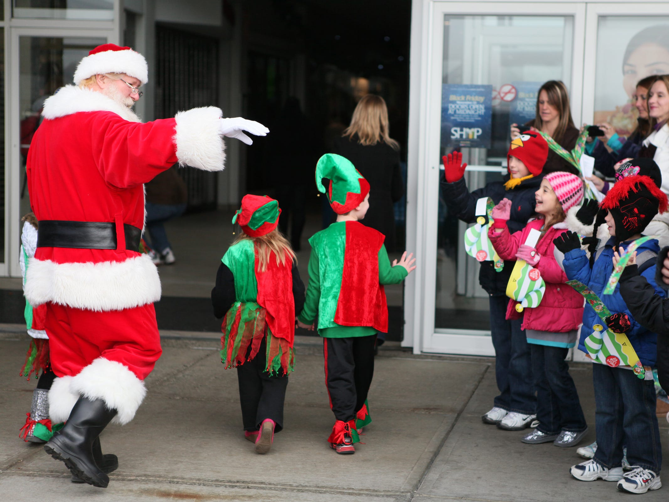 NEED YEAR Santa greets excited children at the Arnot Mall entrance Saturday morning. Santa greets excited children gathered at the Arnot Mall entrance in 2012.