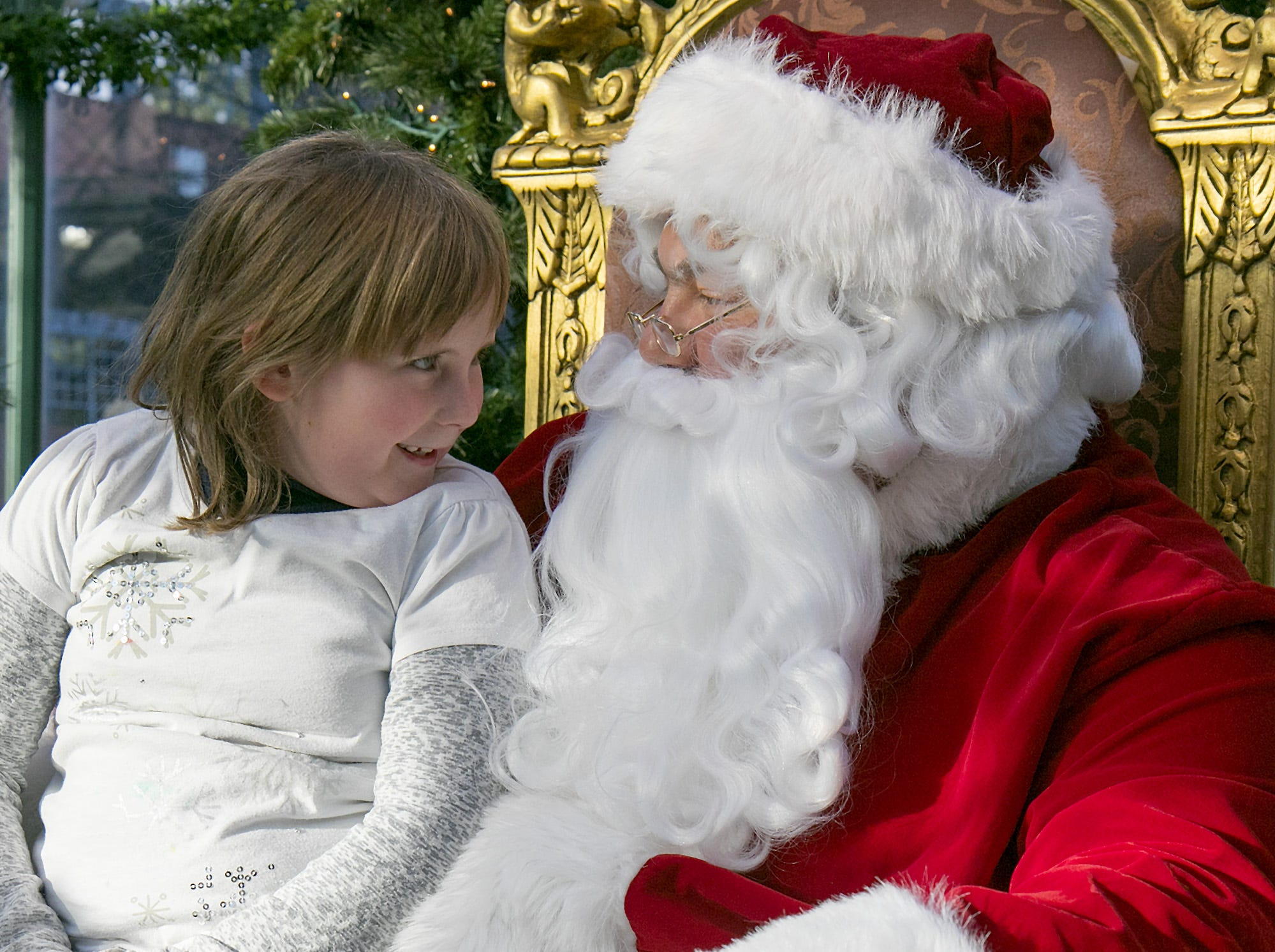 Katie Werner, 7, of Lawrenceville, meets Santa before the start of the Parade of Lights in Corning in 2015.