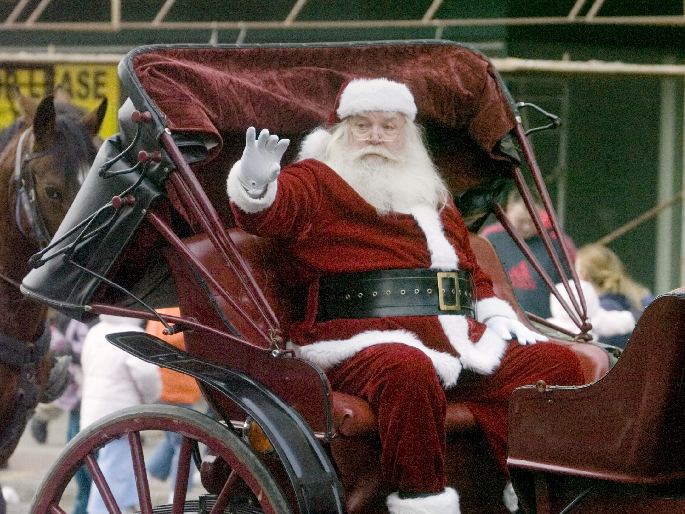 Santa Claus waves to the children Sautrday afternoon in Binghamton during the annual Boscov's Holiday Parade in 2012.