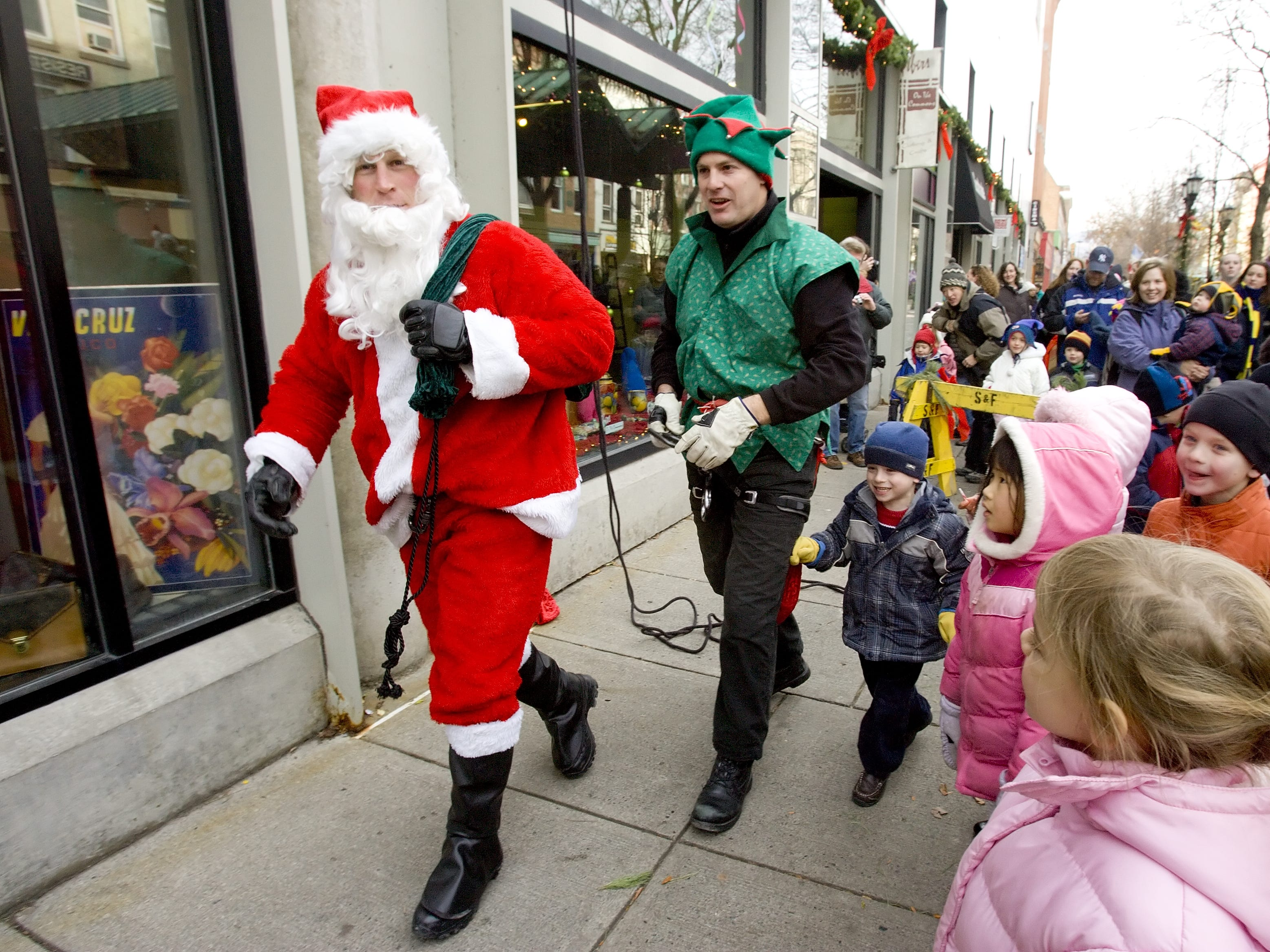 Santa and his elves rappelled off of the roof of Center Ithaca and then entered the building and met with children in order to listen to their Christmas wishes Saturday on The Commons in 2008.