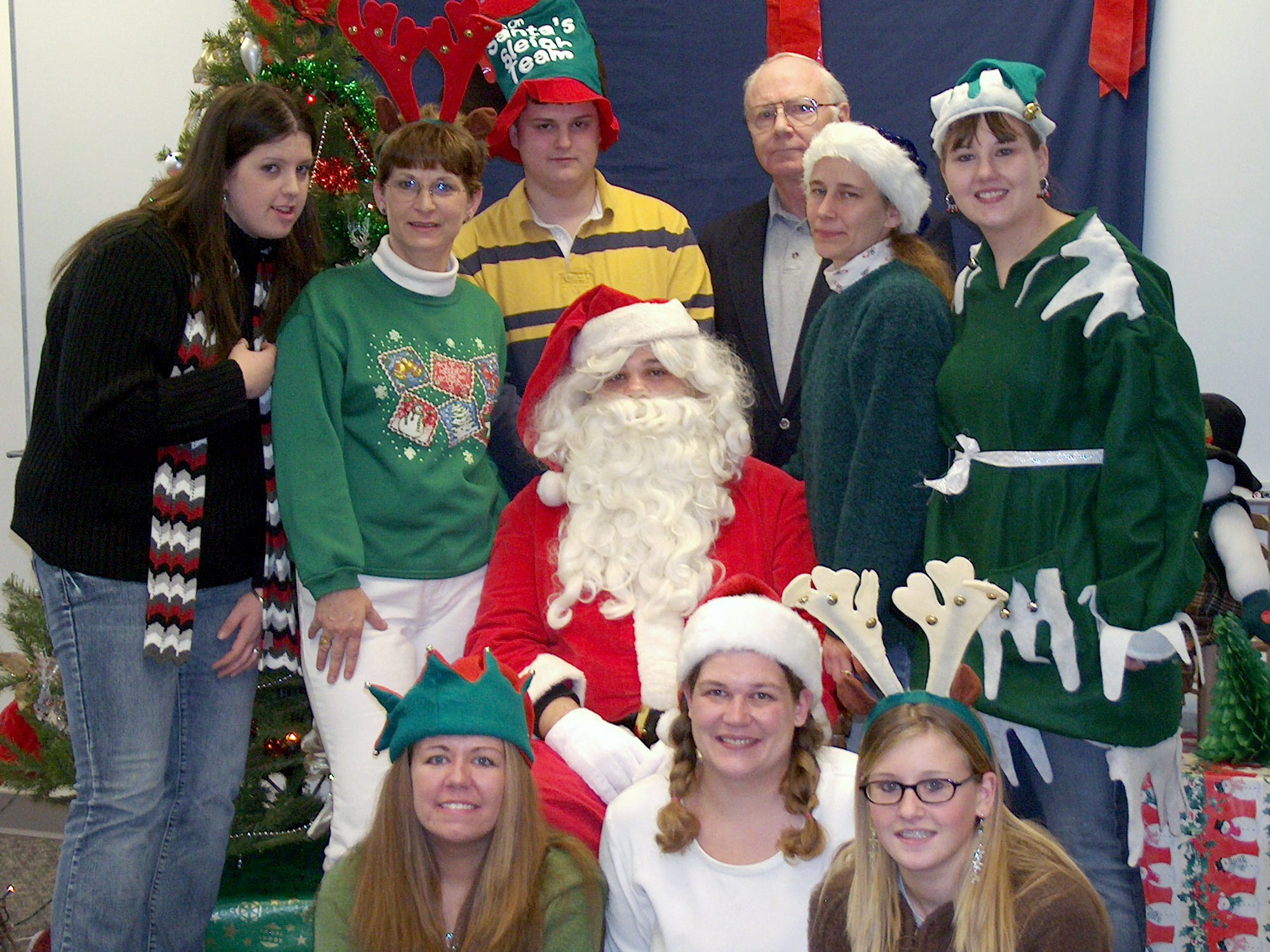 In 2006, Members of the Lackawanna College Student Council in Towanda helped a local charity recently with a pictures with Santa party. The goal was to collect canned and dry food to donate to TACO food pantry.  The students collected three large boxes of food and had about 50 children receive pictures with Santa.  Having their own picture taken were student council members, front from left, Cortney Allen, Ladean Vanderpool and Nicki Sayman, and back from left, Julie Slynn, Linda Fisher, Eric Shannon, Nate Reeves as Santa, adviser Jack Fox, Karen Keener and Tanya Sayman as an elf.