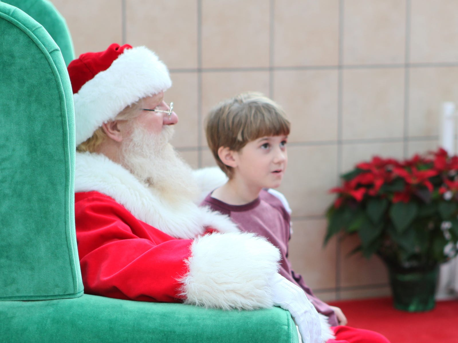 Peyton McClure, 7, of Wellsboro, has his picture taken with Santa in 2012.