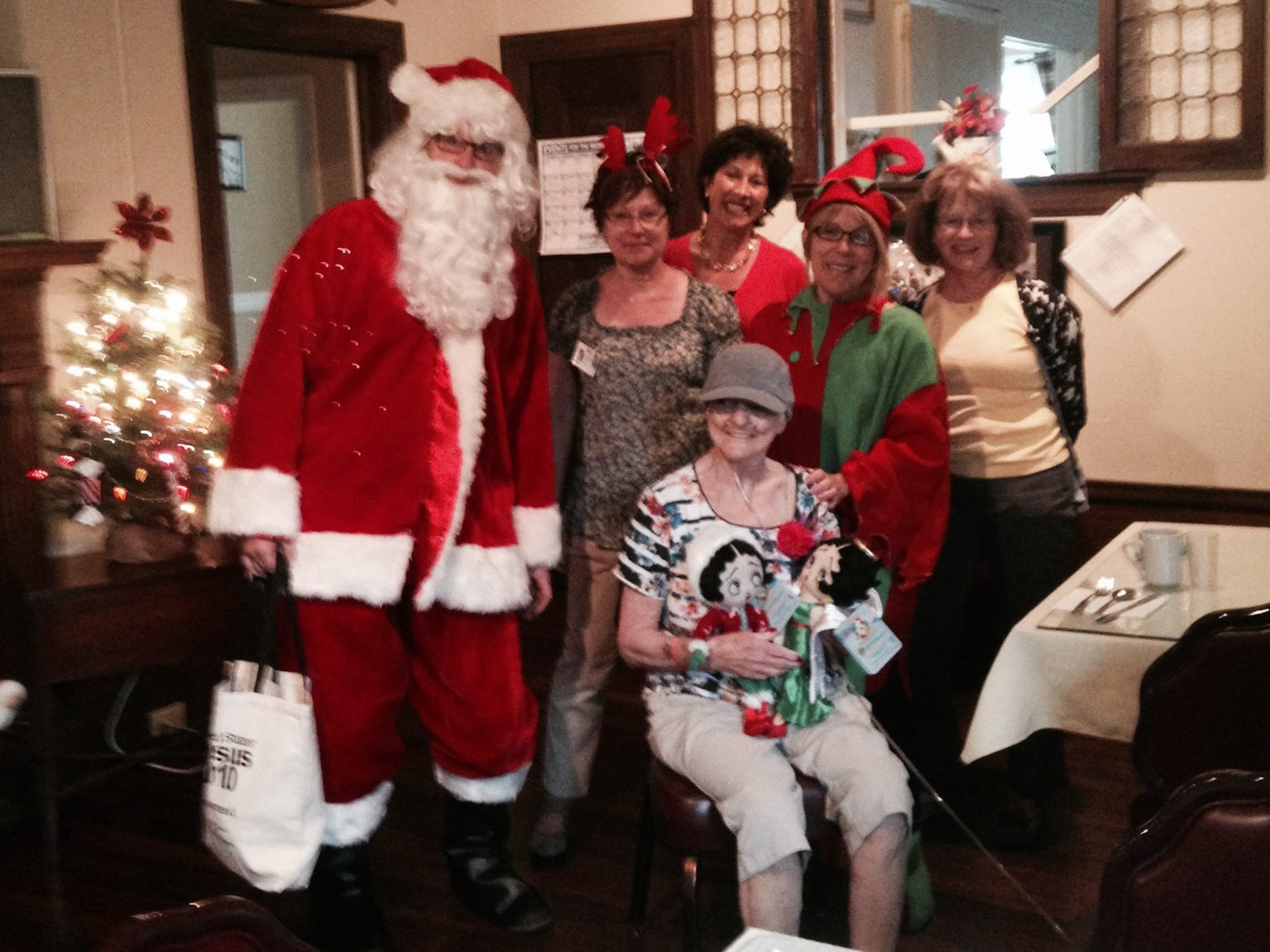 In 2015, Chemung County Adult Protective Services staff provided a Christmas in July party Wednesday for Barton Home resident Theresa Aherns. Pictured, from left are: Bill Wandell (Santa), Lisa Kruckow, Kim Patterson, Janice Staples (elf), Mary Burin and, seated, Theresa Aherns.