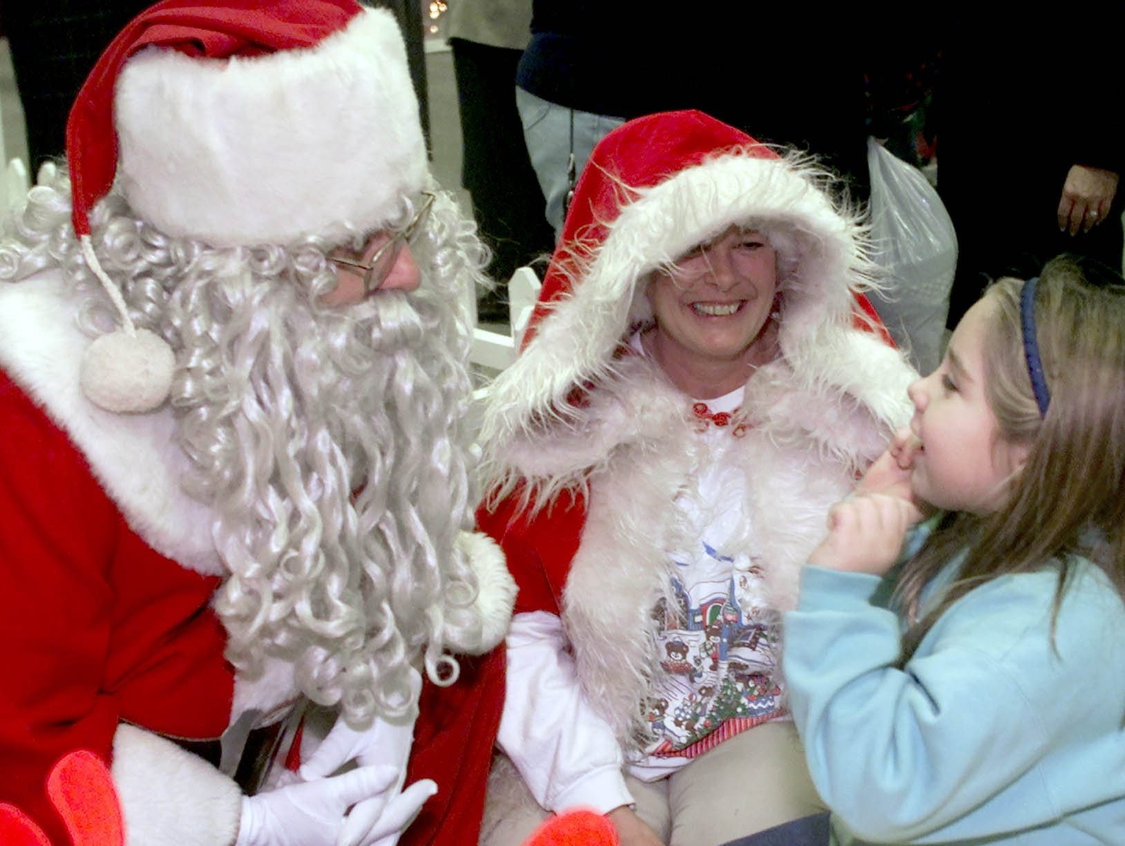 "Tiffany Gilboy, 6, of Elmira tells Santa Claus her wish for a ""big giant doll house,"" but suggests that Mrs. Claus do the ""good girl shopping"" Wednesday, November 13 at the Salvation Army Red Kettle Kick-Off at Arnot Mall."