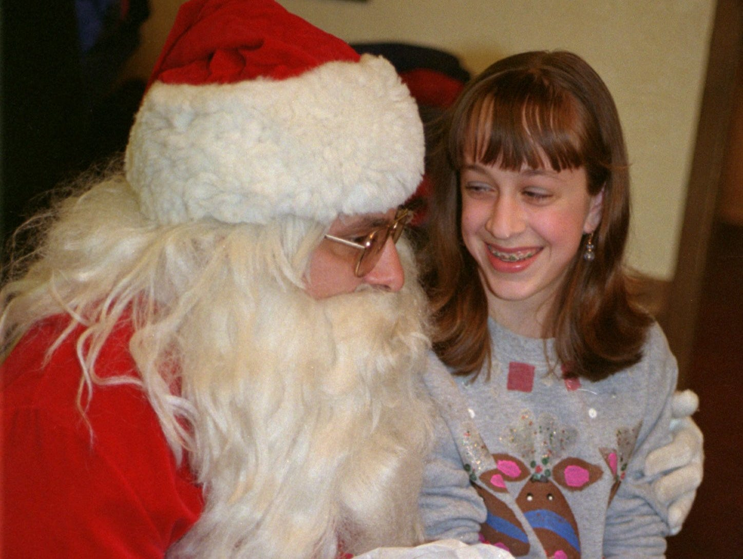 12/24/99; 2C:  Fourteen year old Amy Trosino got an early gift from Santa at a recent Christmas party for children with cancer at Hoss's in elmira. Amy lost her brother to cancer three years ago.
