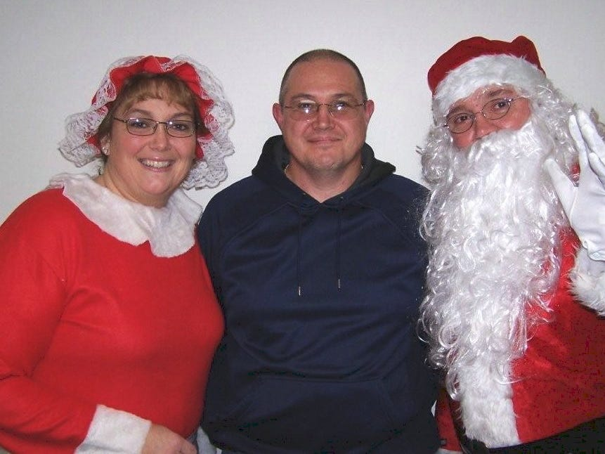Athens Township Fire Chief Dean Covey greets Santa and Mrs. Claus at the Athens firehouse in 2007.