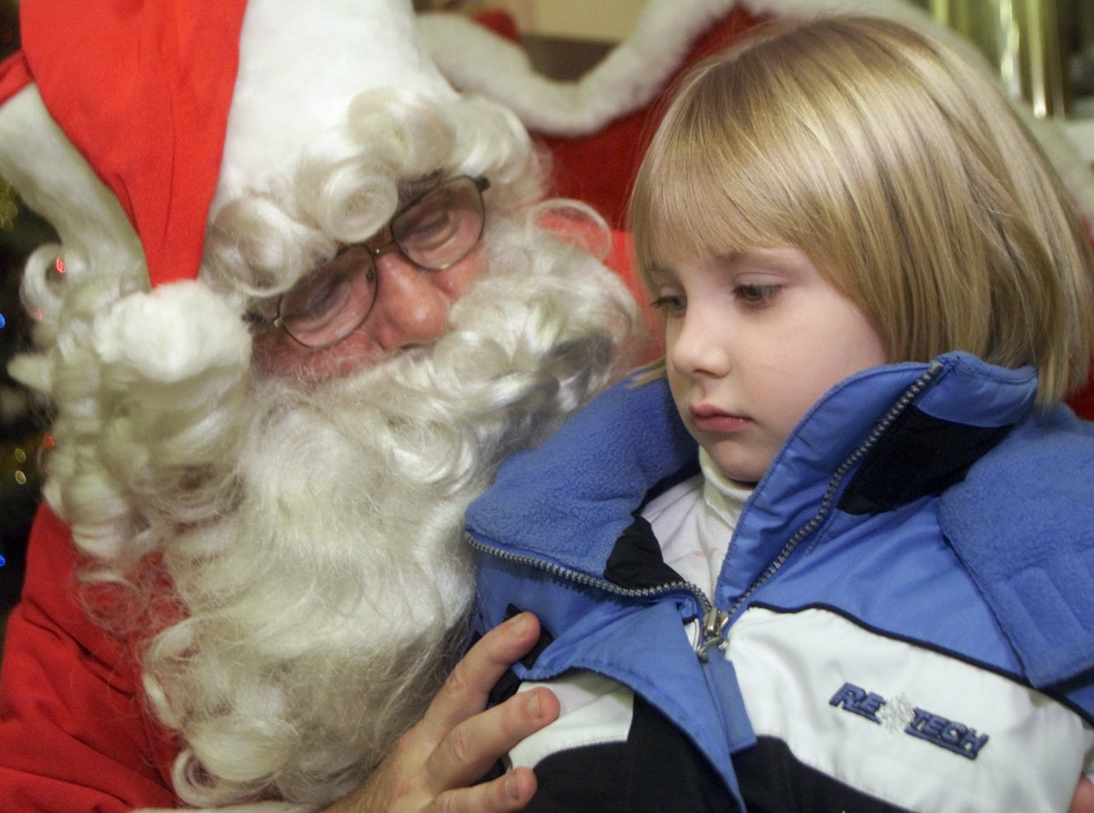 12/9/2002, 1C:   Kaitlin Karski, 5, of Southport, visits with Santa Claus on Sunday during A Night of Holiday Magic at the Southport Fire Department firehouse.