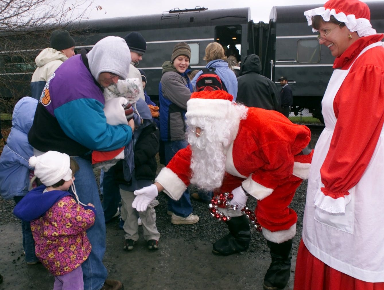 12/13/2004, 3C; 11/28/2005, 3C:   Santa and Mrs. Claus greet passengers Saturday bound for the Finger Lakes Scenic Railway's Santa Train in Watkins Glen. The railway offered three holiday rides Saturday as part of a fund-raiser for the American Stroke Association.