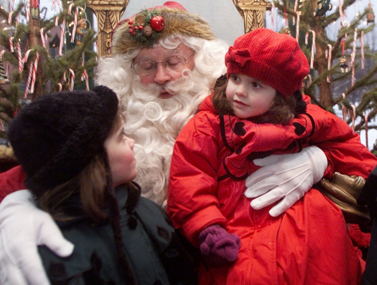 -  -Text: Four-year-old Rose Ruland, left, of Corning and her three-year-old sister, Grace, visit Kris Kringle in his Crystal House at Centerway Square Saturday evening as Corning's Sparkle gets underway.