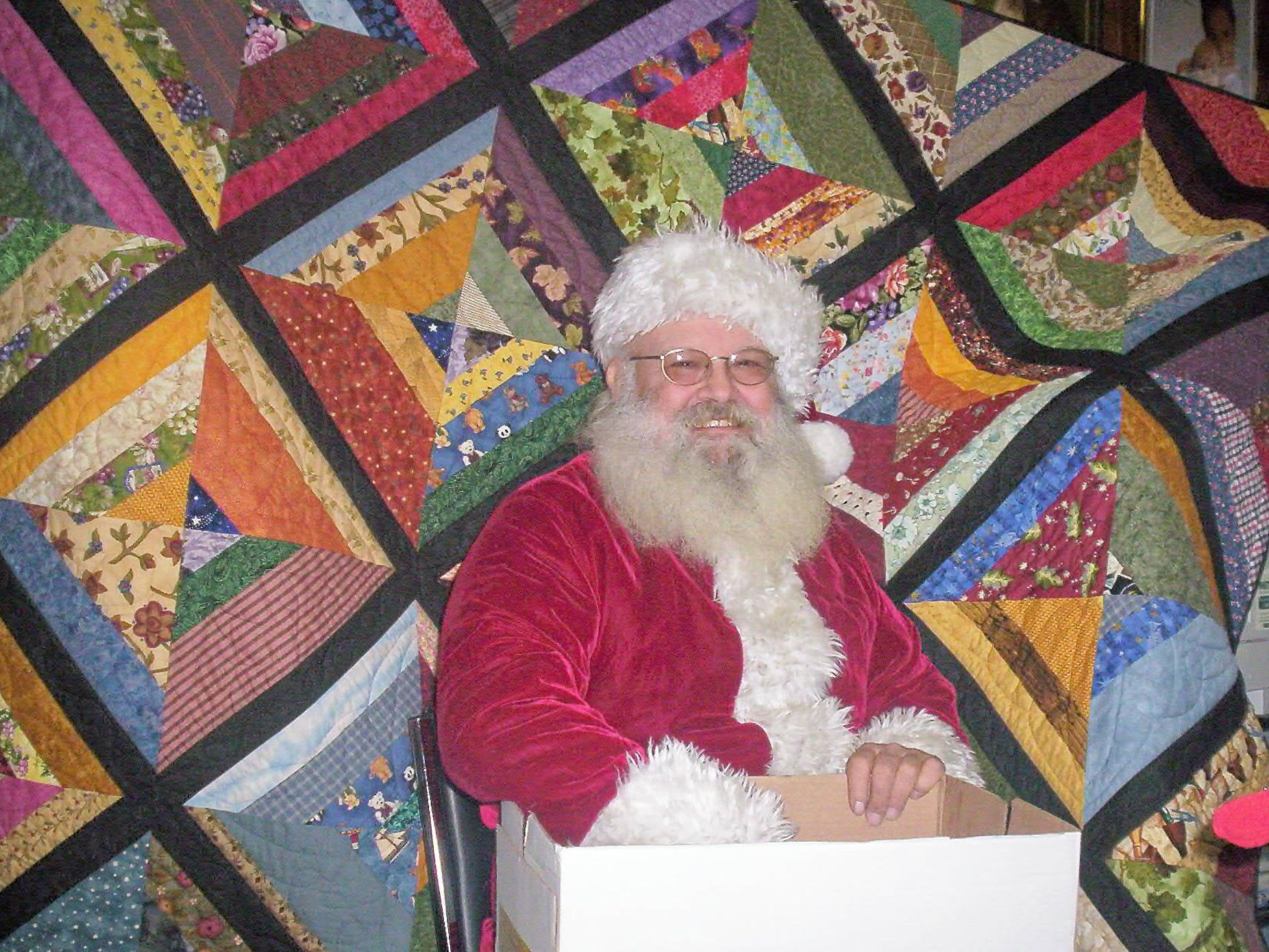 In 2006, SPCA leashes holiday spirit Santa Claus -- Steve Saltsman of Avoca -- poses with the quilt that was raffled by the Finger Lakes Society for the Prevention of Cruelty to Animals in Bath. Jeanne Fisher of Buffalo, a former Steuben County resident, won the quilt and the SPCA raised $1,200 for the shelter and its programs.