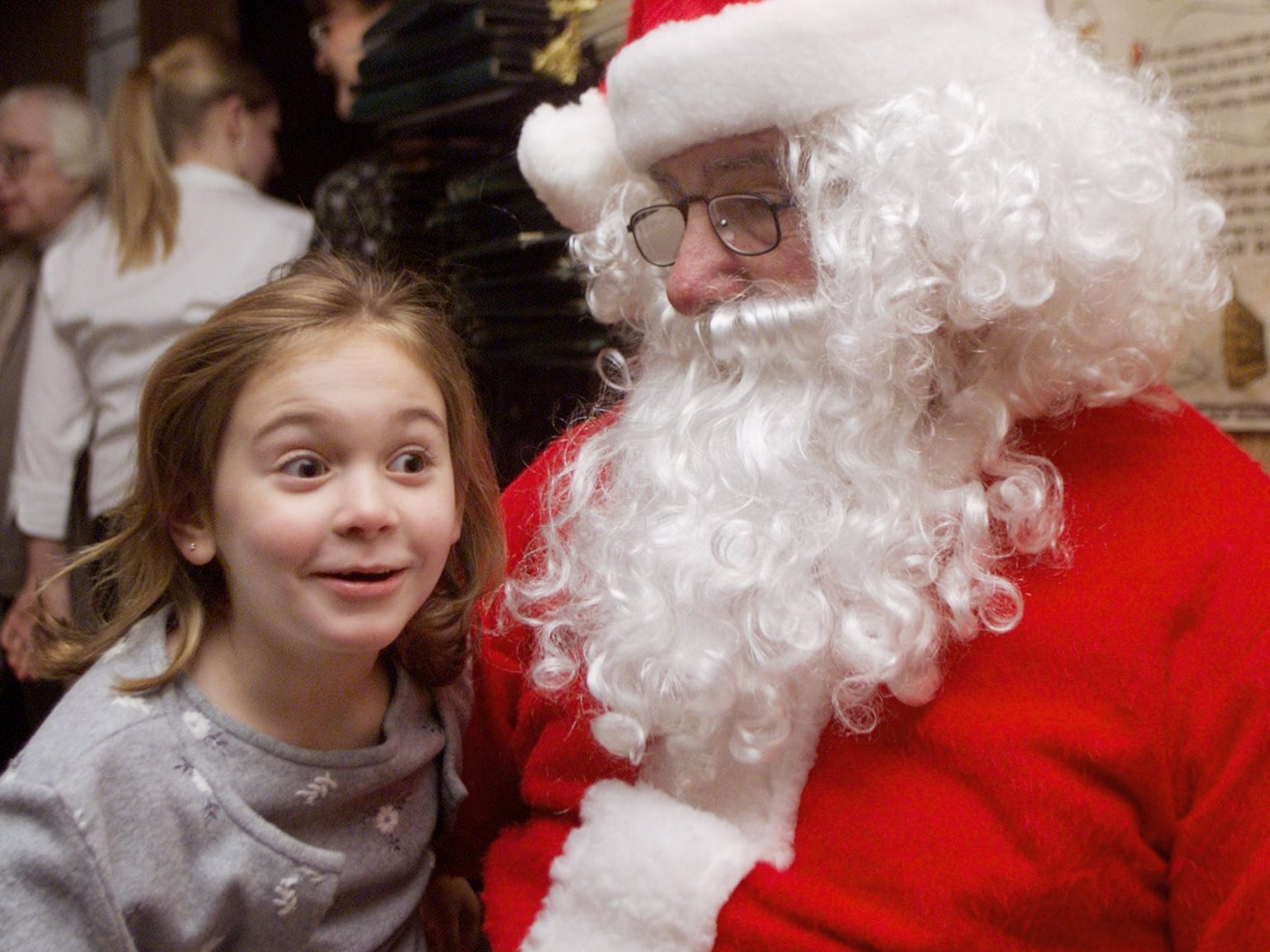 "In 2003,, Madeline Blide, 6, of Horseheads, tells Santa Claus what she wants for Christmas during the annual wreath lighting held Monday night at Hill Top Inn in Elmira. The ""Love Lights a Wreath"" event at Hill Top raised funds for the American Cancer Society."