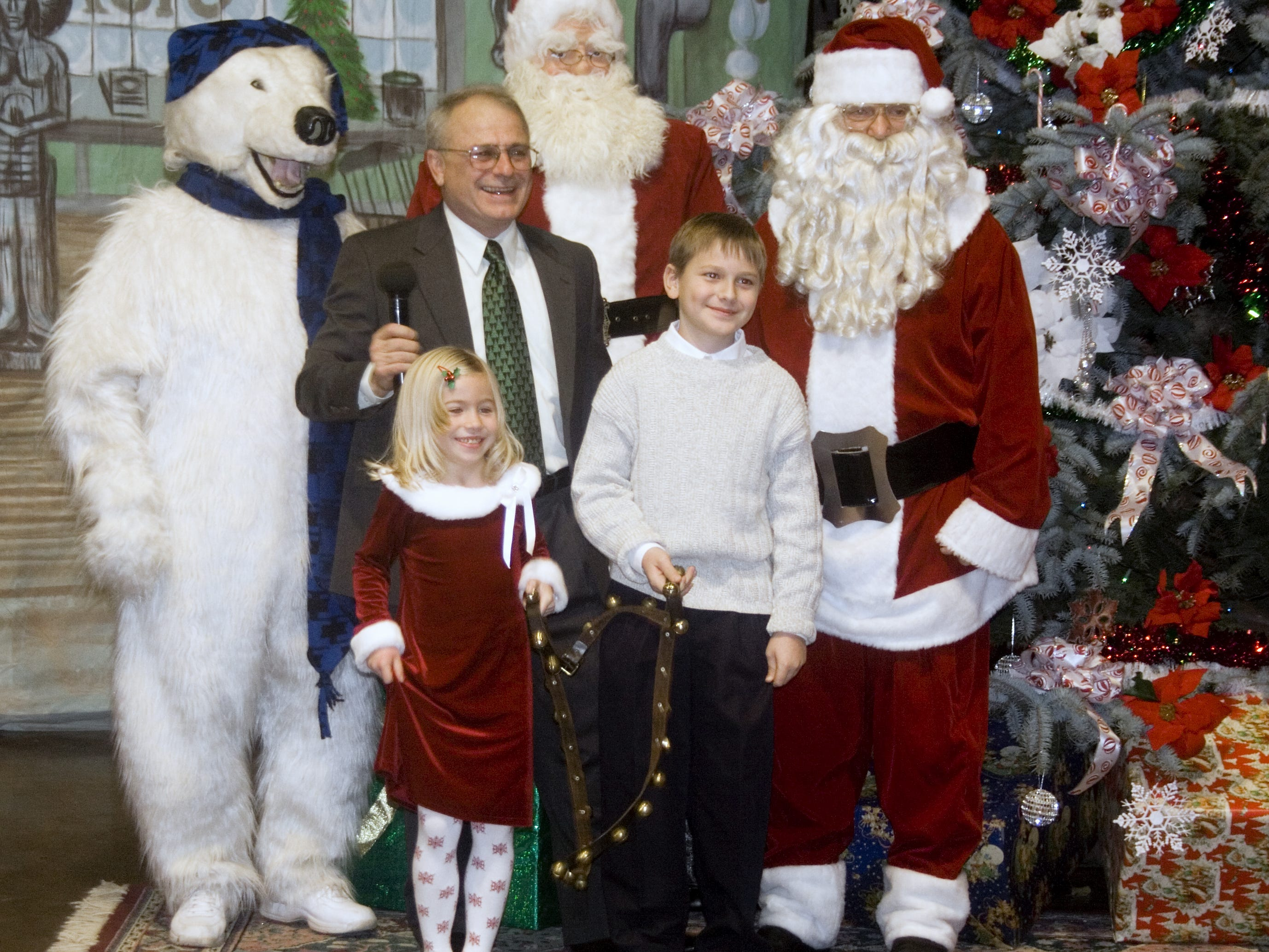 Santa Claus and the Arctic League mascot join master of ceremonies Tom Bruner and bell ringers Alecia McKillip and Lucas Peris during the 2007 annual broadcast.