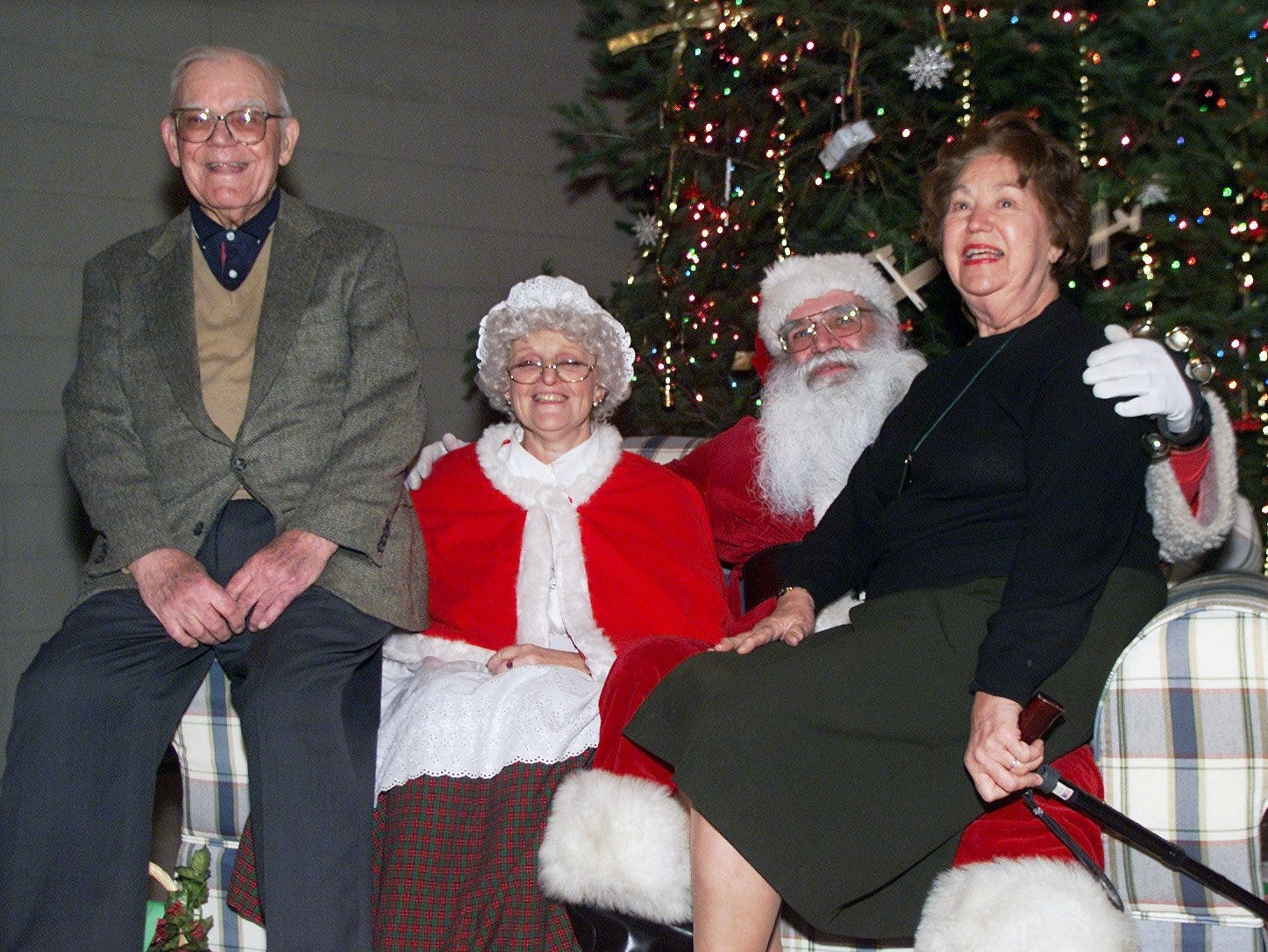 Paul and Virginia Schweizer of Big Flats pose for photos with Mr. and Mrs. Santa Claus during the Kitty Hawk Day open house at the National Soaring Museum in 1999.