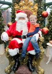 Jessica Northup / Provided Photo Sawyer Lyon, 5, of Corning, sits on Santa's lap in the Gaffer District's crystal house in 2015.