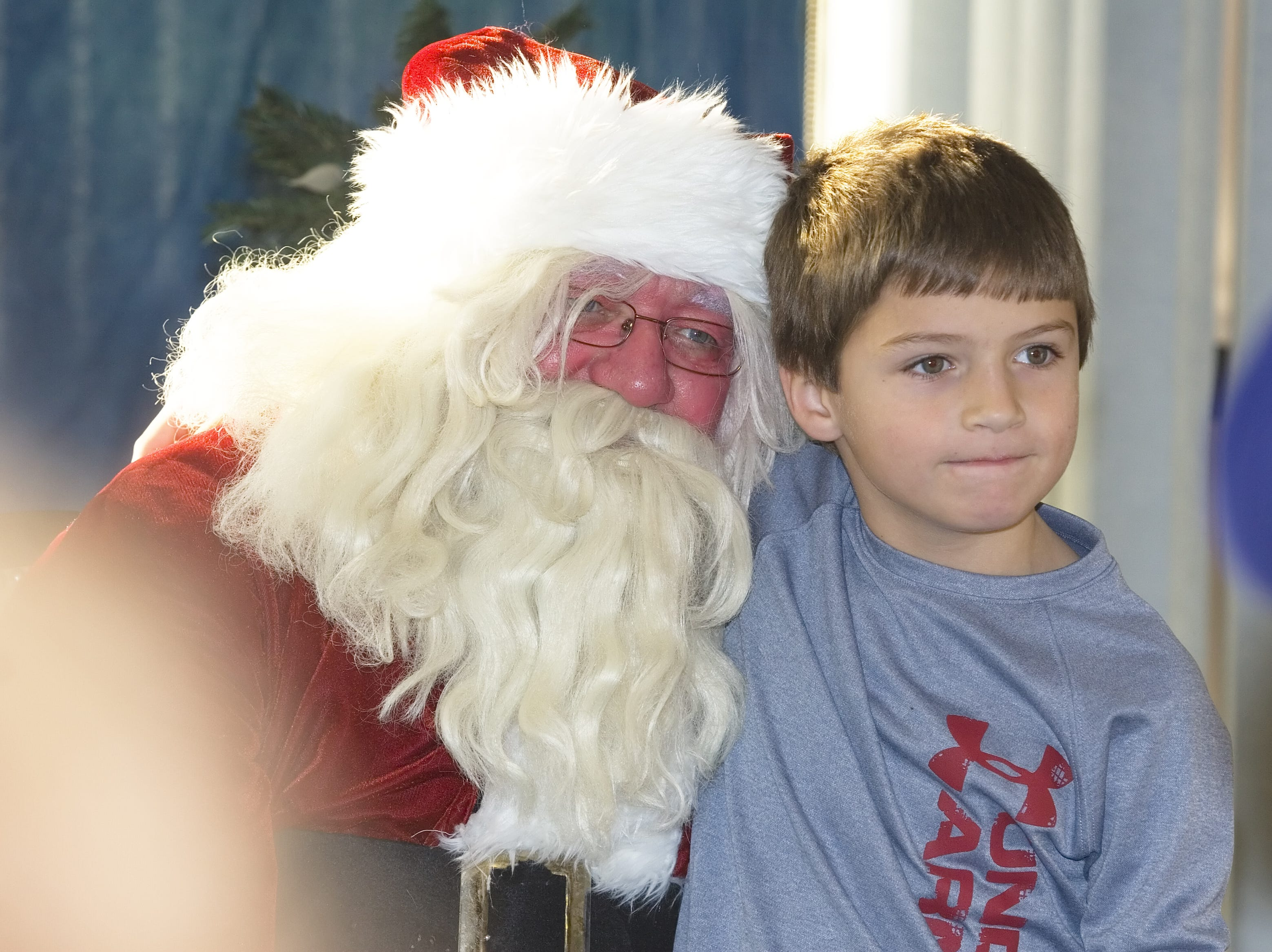 NEED YEAR Ryan Bennett, 8, of Waverly, poses with Santa on Saturday during Breakfast with Santa at Robert Packer Hospital in Sayre.