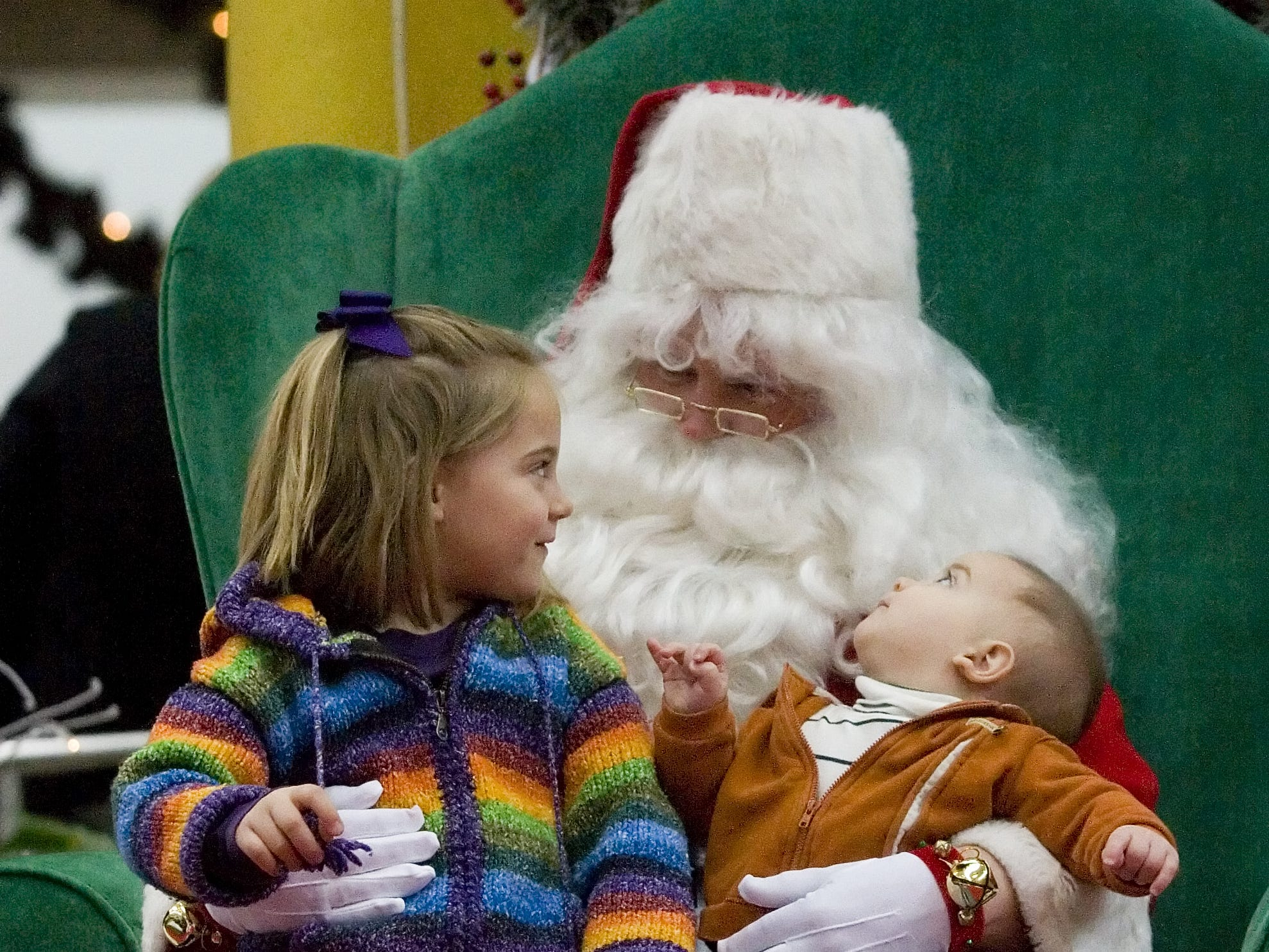 Julianna Mastrantonio, 4, and brother Joseph, 6 months, talk to Santa before having their picture taken Saturday at center court in Arnot Mall in Big Flats in 2007.