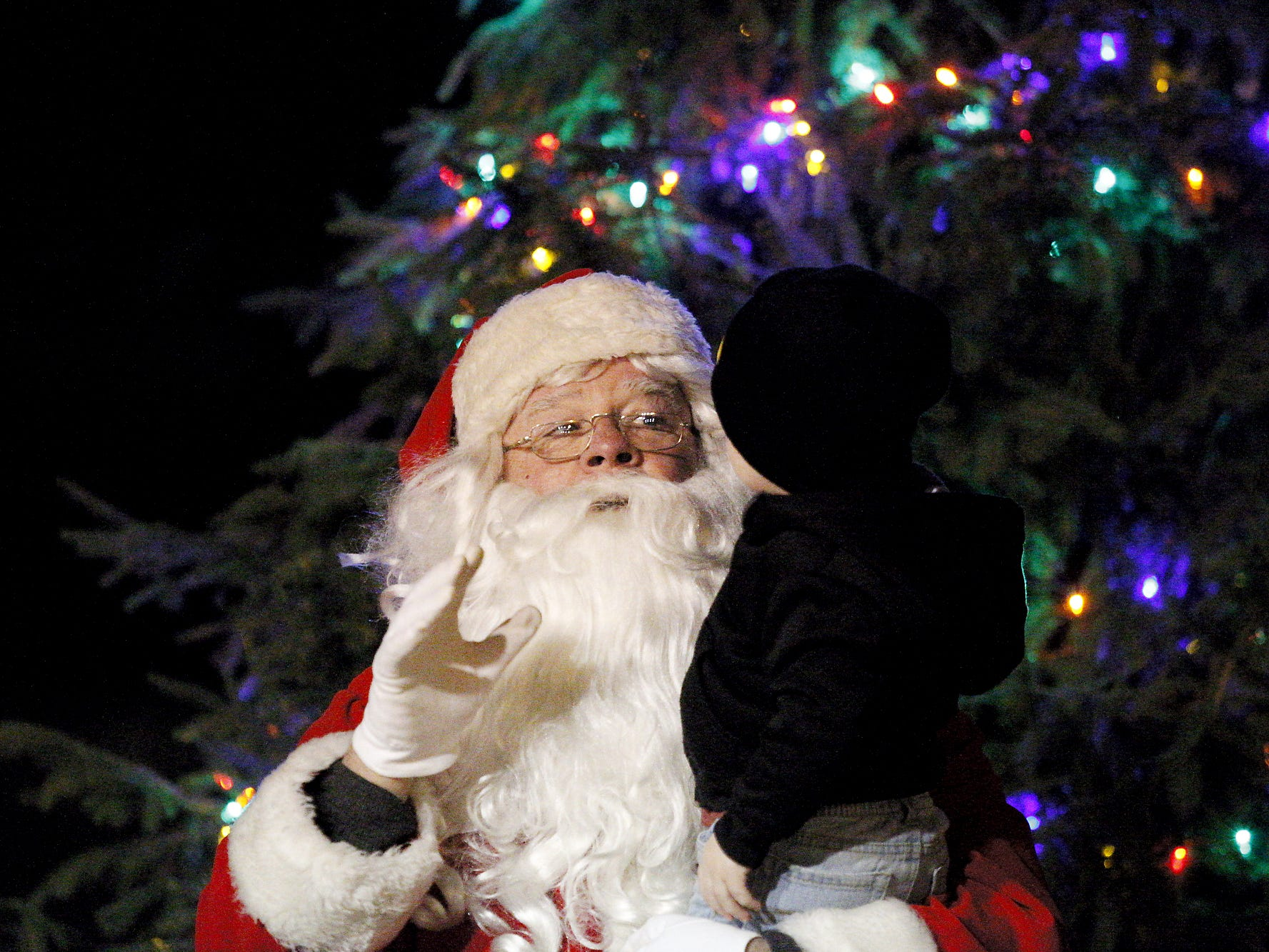Santa greets visitors at the tree-lighting ceremony Tuesday at Riverfront Park in 2015.